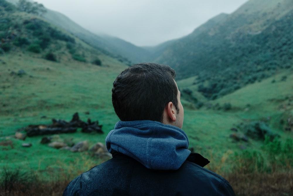 man looking on mountains during daytime