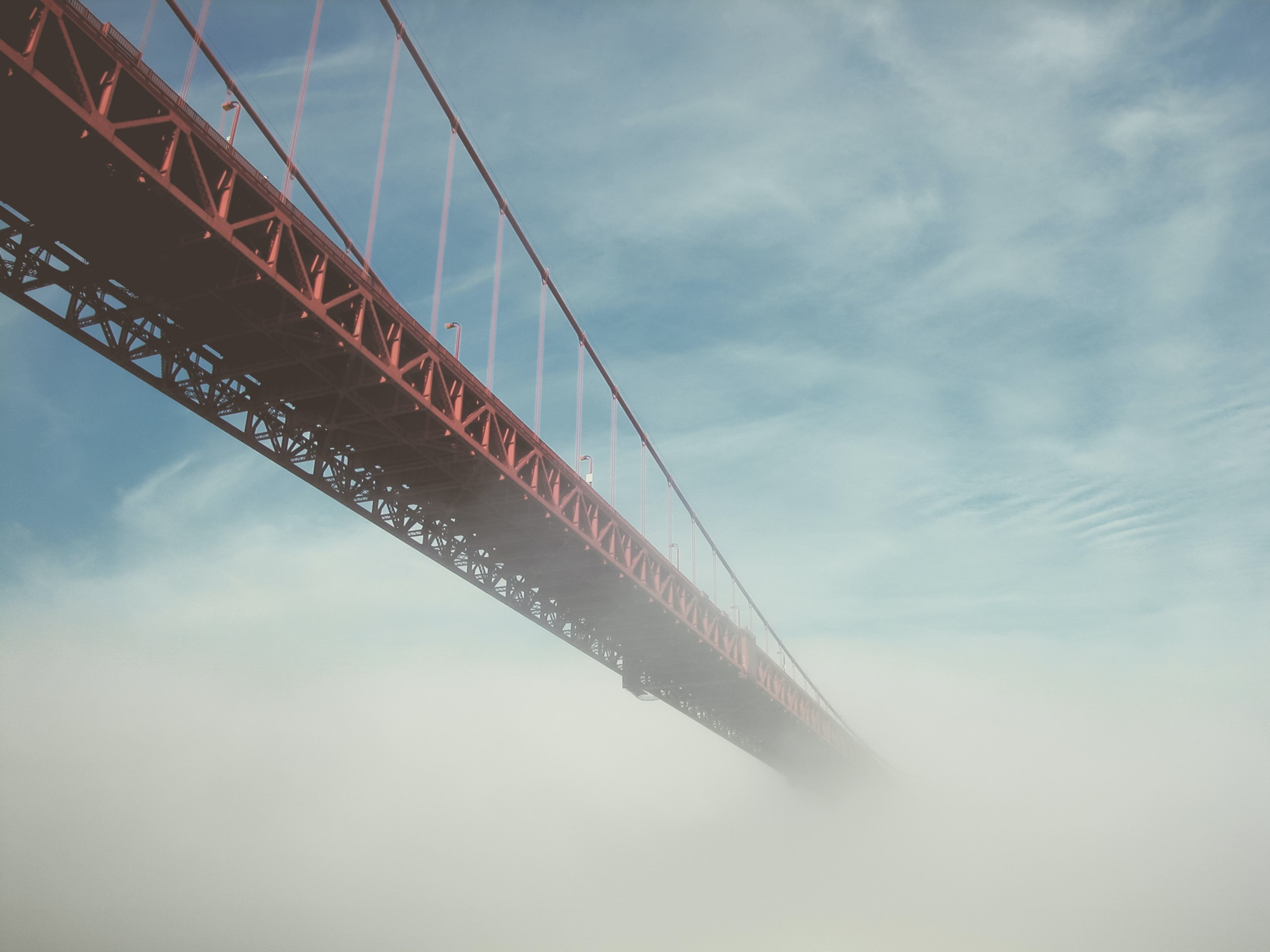 Golden Gate Bridge disappears into the cloudy fog