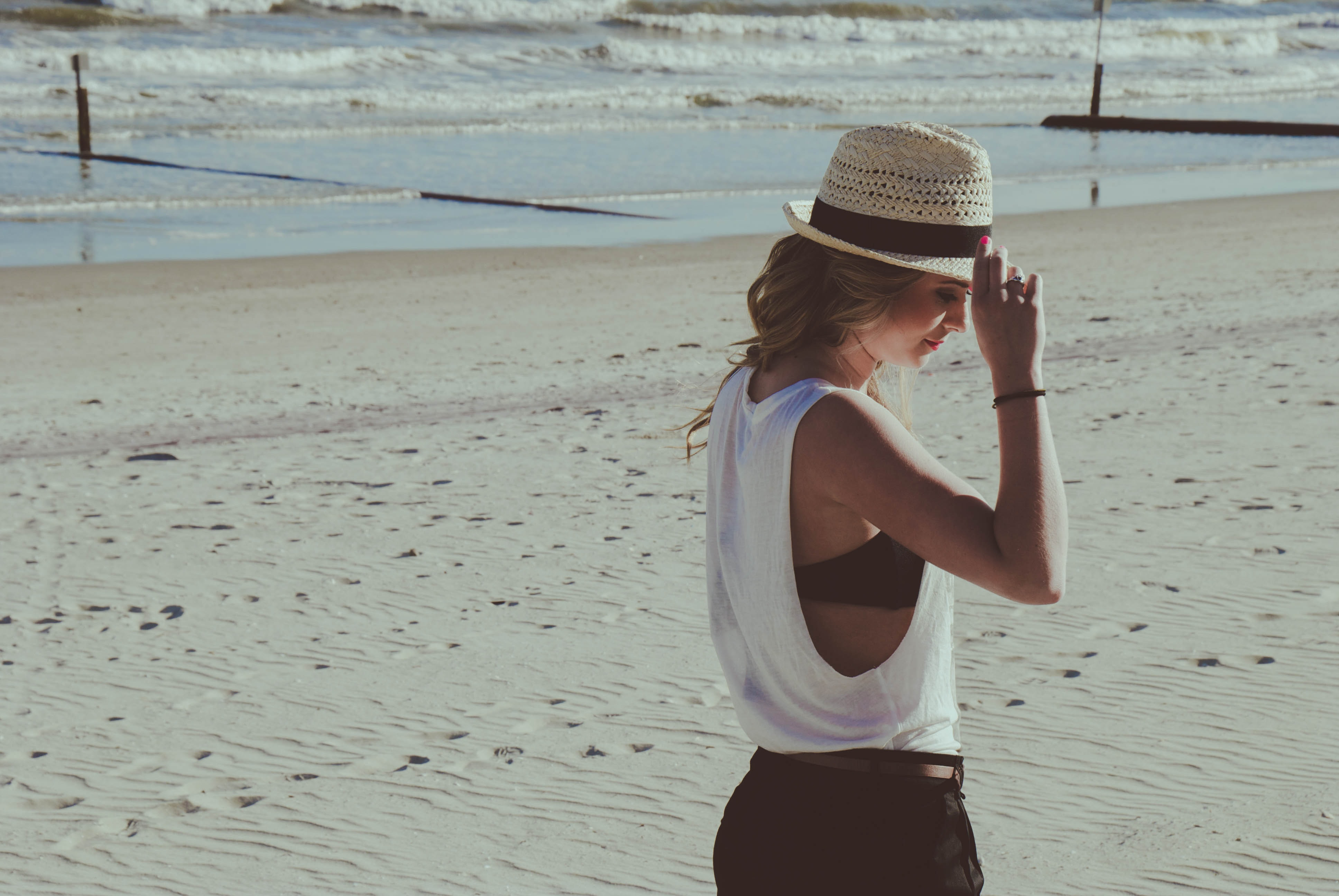 Woman with a hat on the Myrtle Beach sand coastline