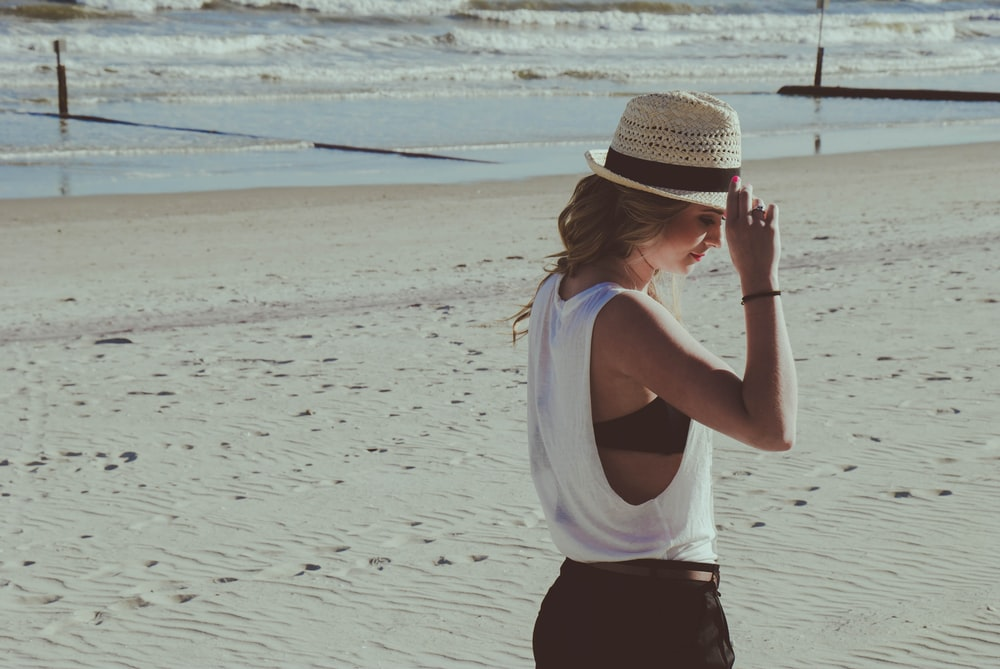 woman standing on beach sand