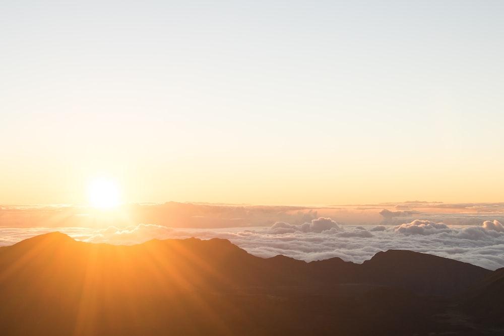 mountain range under golden hour