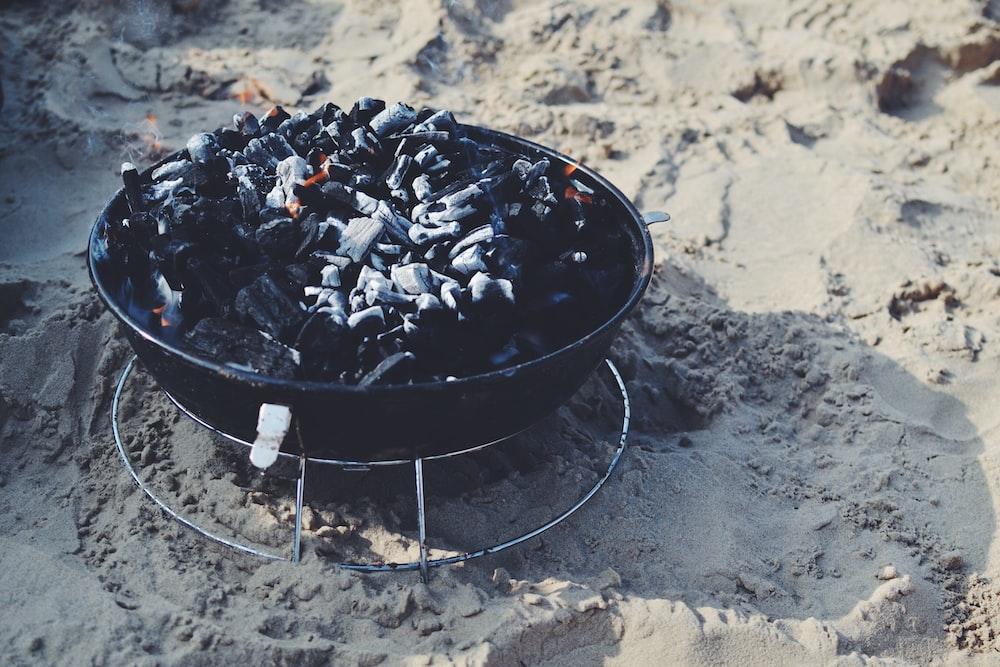 black fire pit on sand