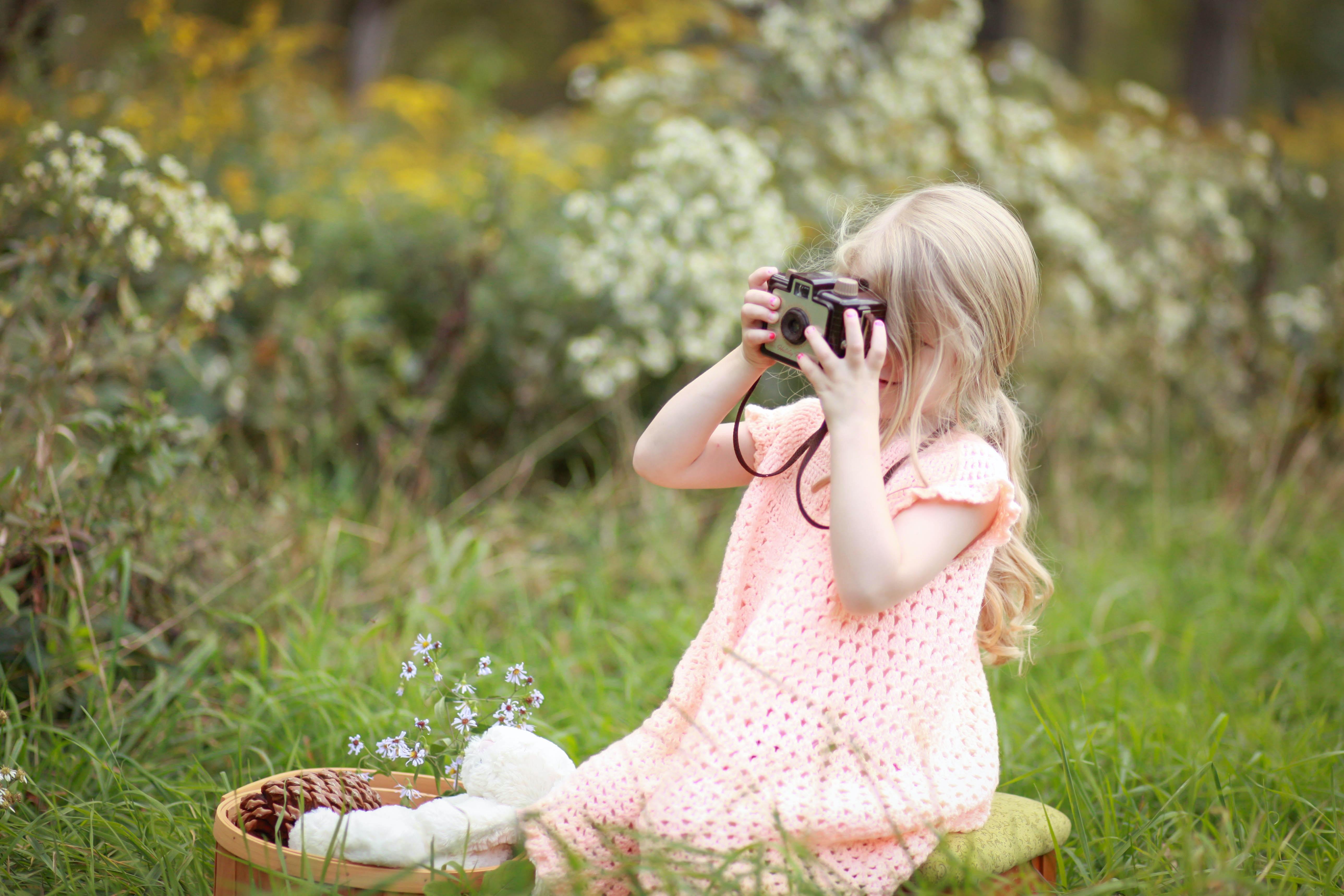 girl taking photo