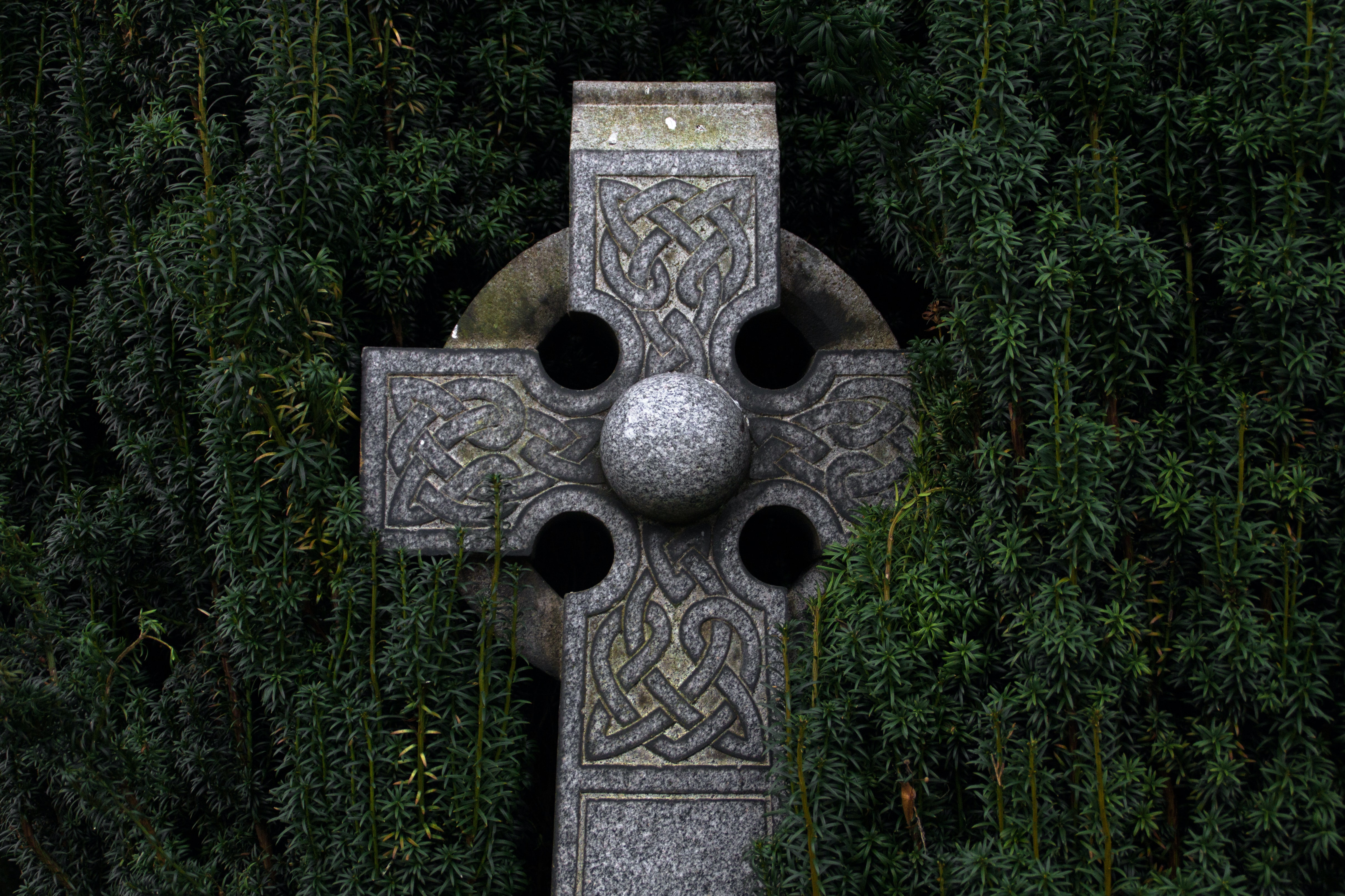 gray concrete cross statue