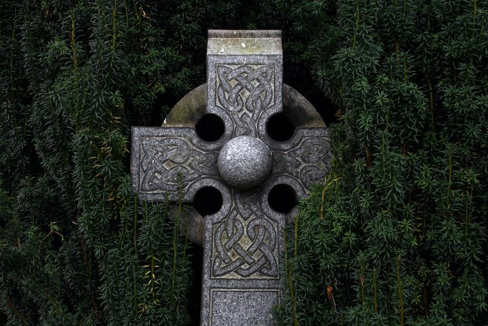 gray concrete cross statue