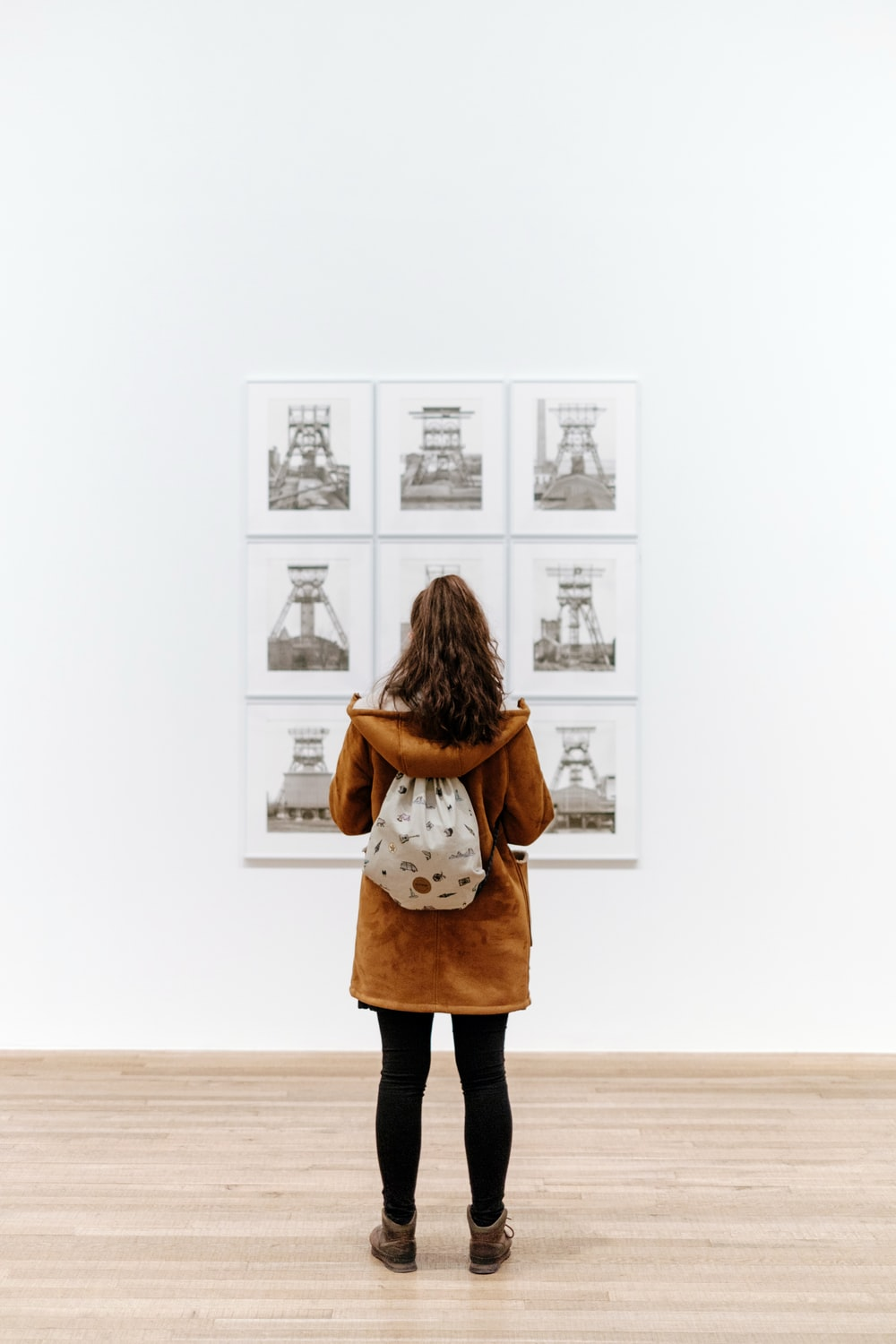 woman standing in front of painting inside the building