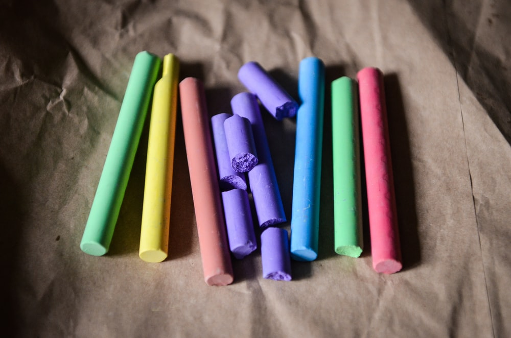 seven assorted-color of chalks gray surface