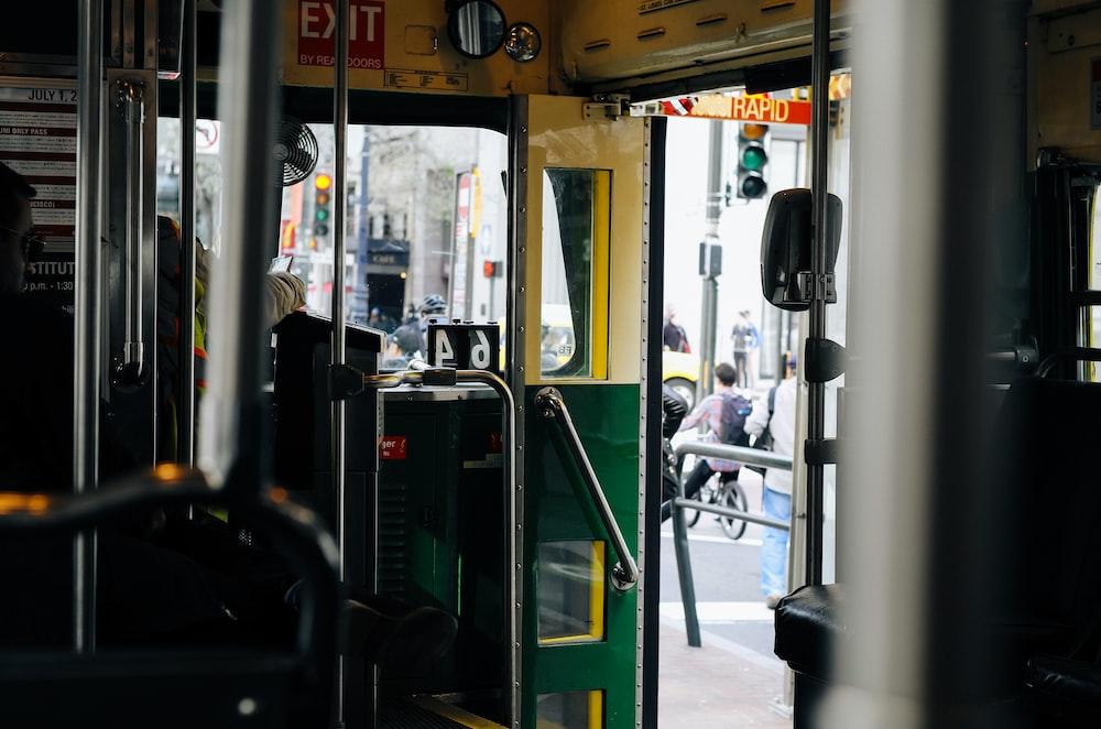 selective focus photograph of green and yellow door of tram