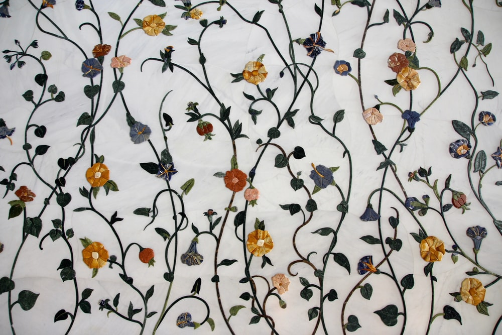 white, orange, and purple floral textile