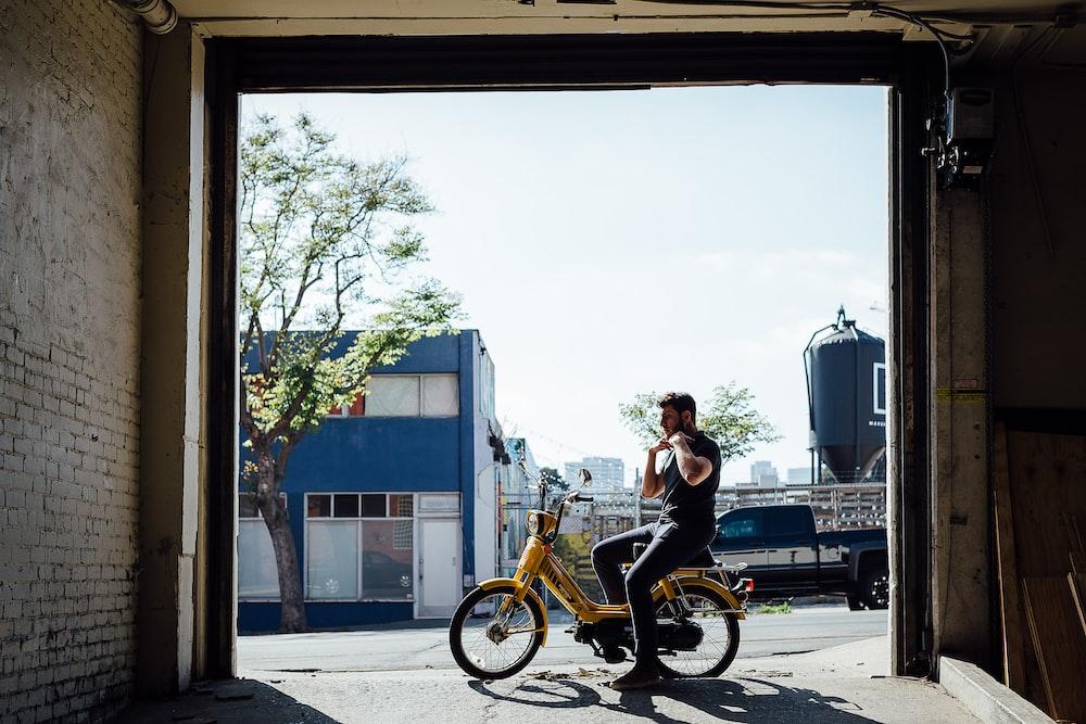 man riding electric motorcycle