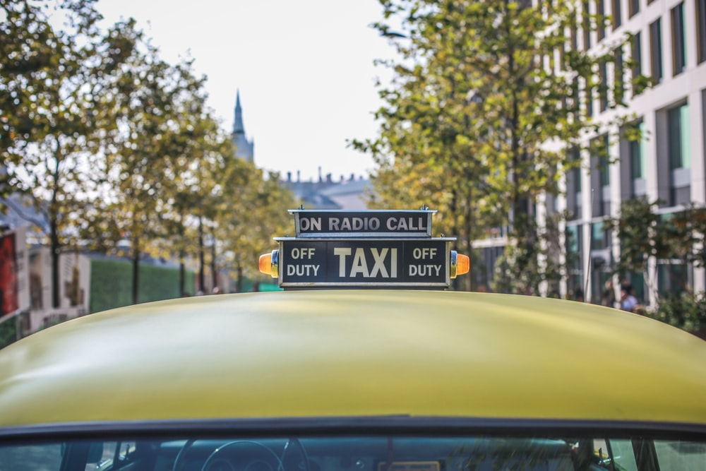 selective focus photography of taxi cab signage
