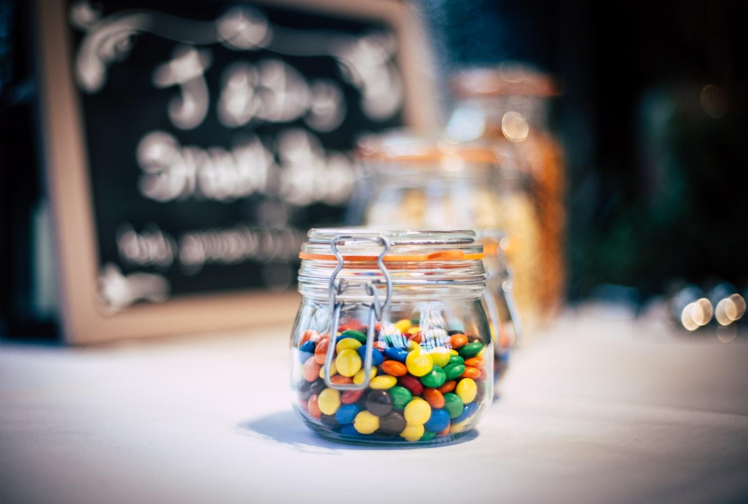 m&m chocolates inside glass jar
