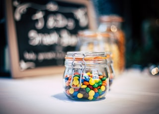 round candies in clear glass jar with clamp lid
