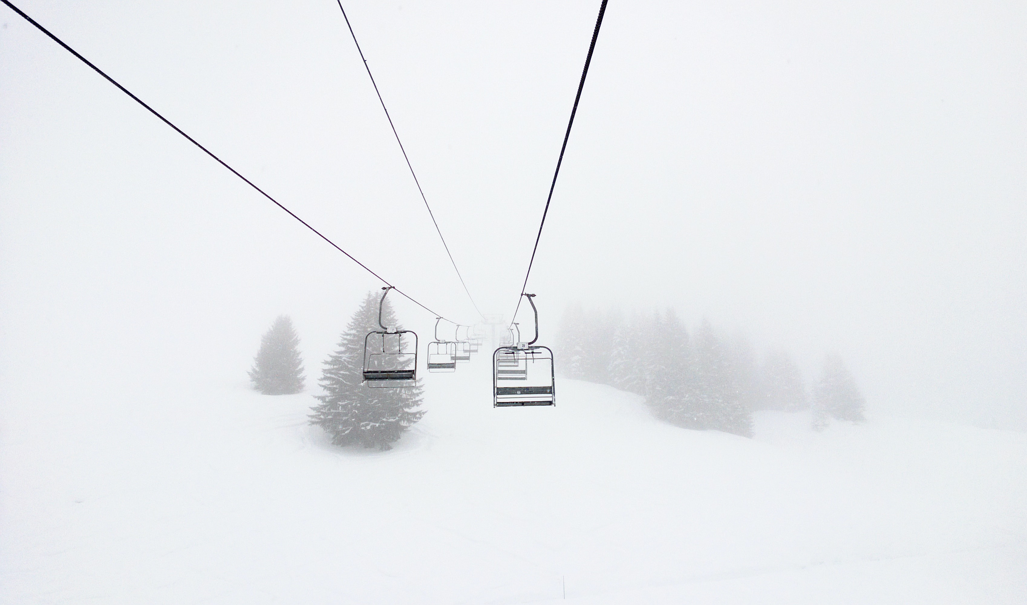 Chairlifts on a snowy ski slope in Morillon