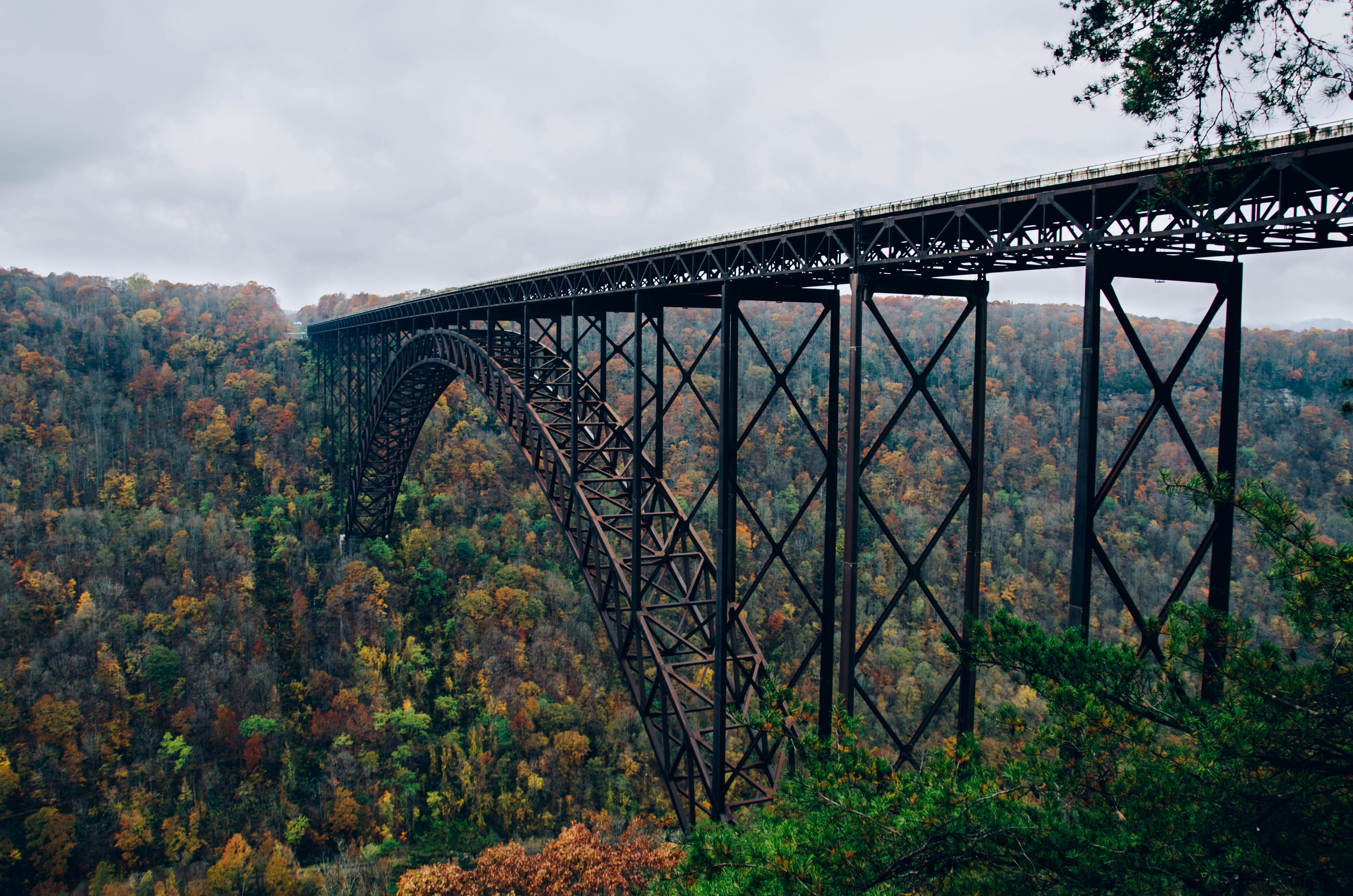 A long old steel bridge over a wooded ravine in Fayetteville