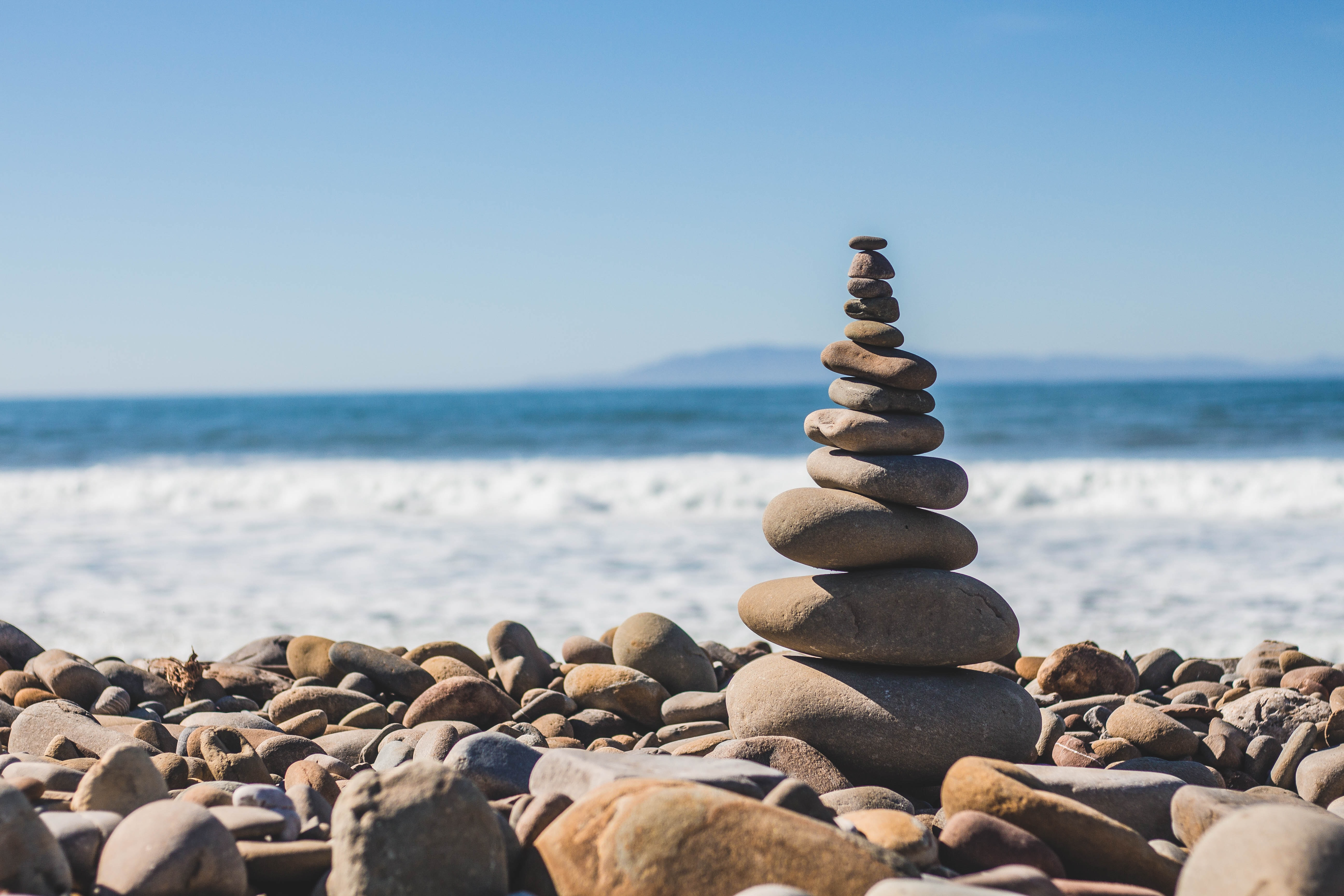 Stone balancing with pebble tower on the Ventura rocky beach