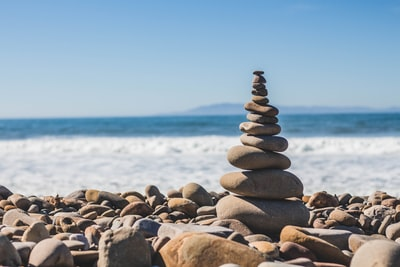 nature, coast, beach, shore, water, rocks, stones, pile, art, zen, waves, bubbles, froth, mountains, sky, horizon