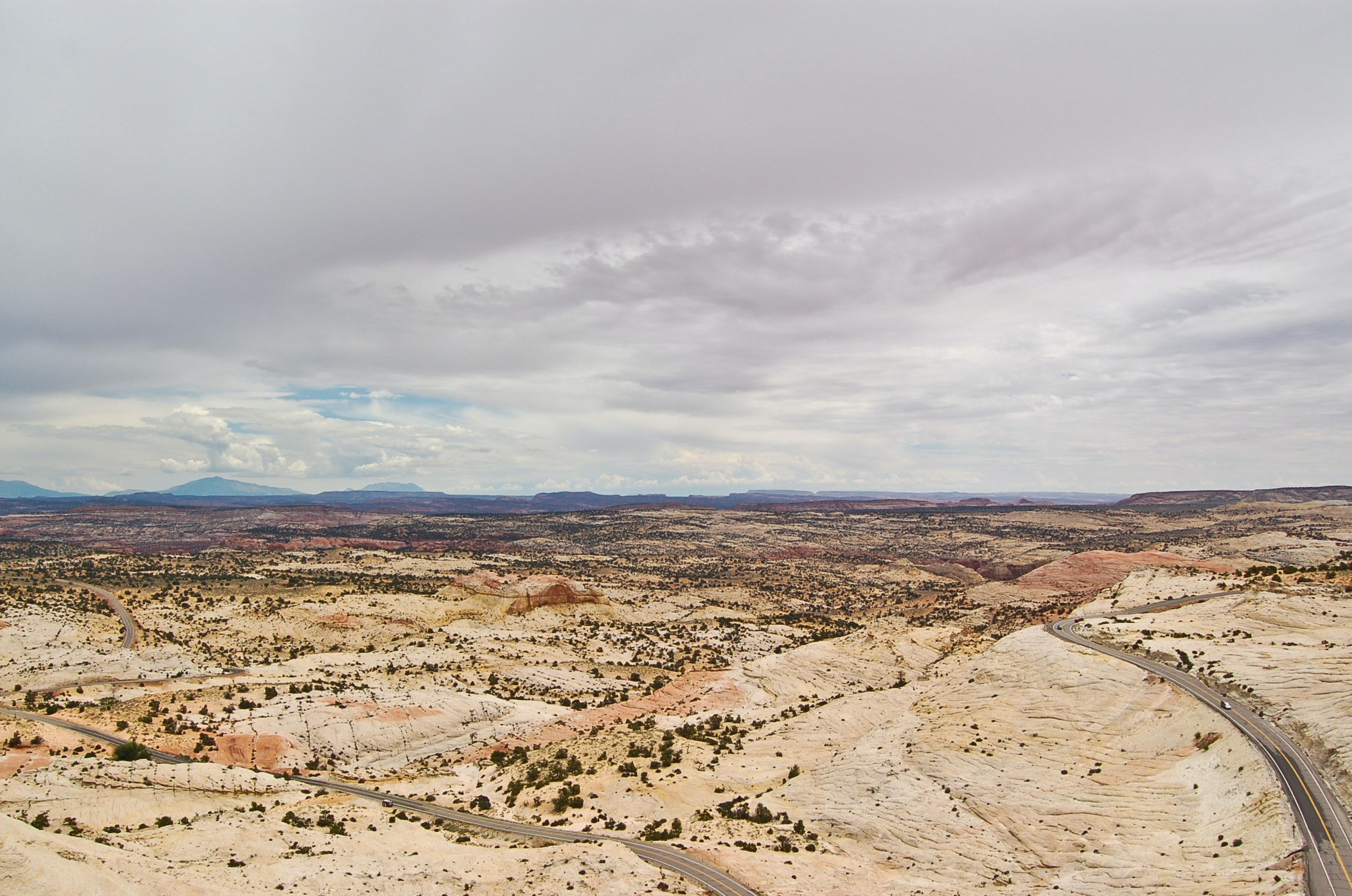 aerial shot of dried land under cloudy sky