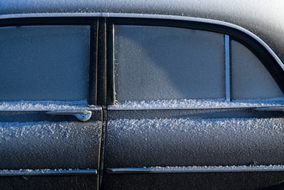 gray vehicle covered by snow