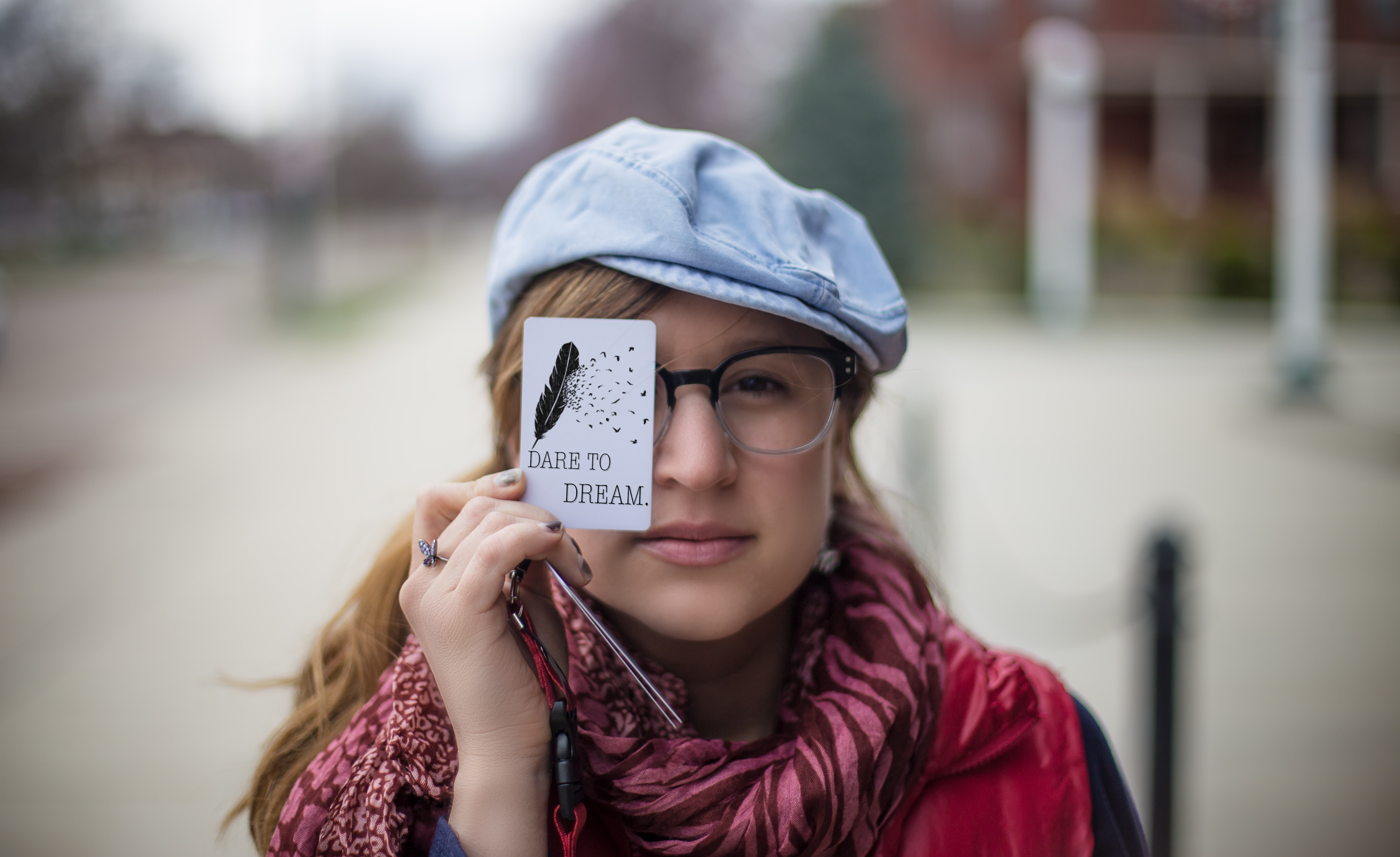 woman holding white card