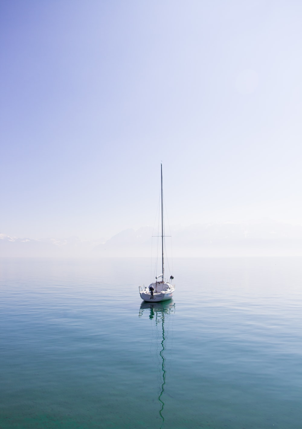 white boat on a body of water