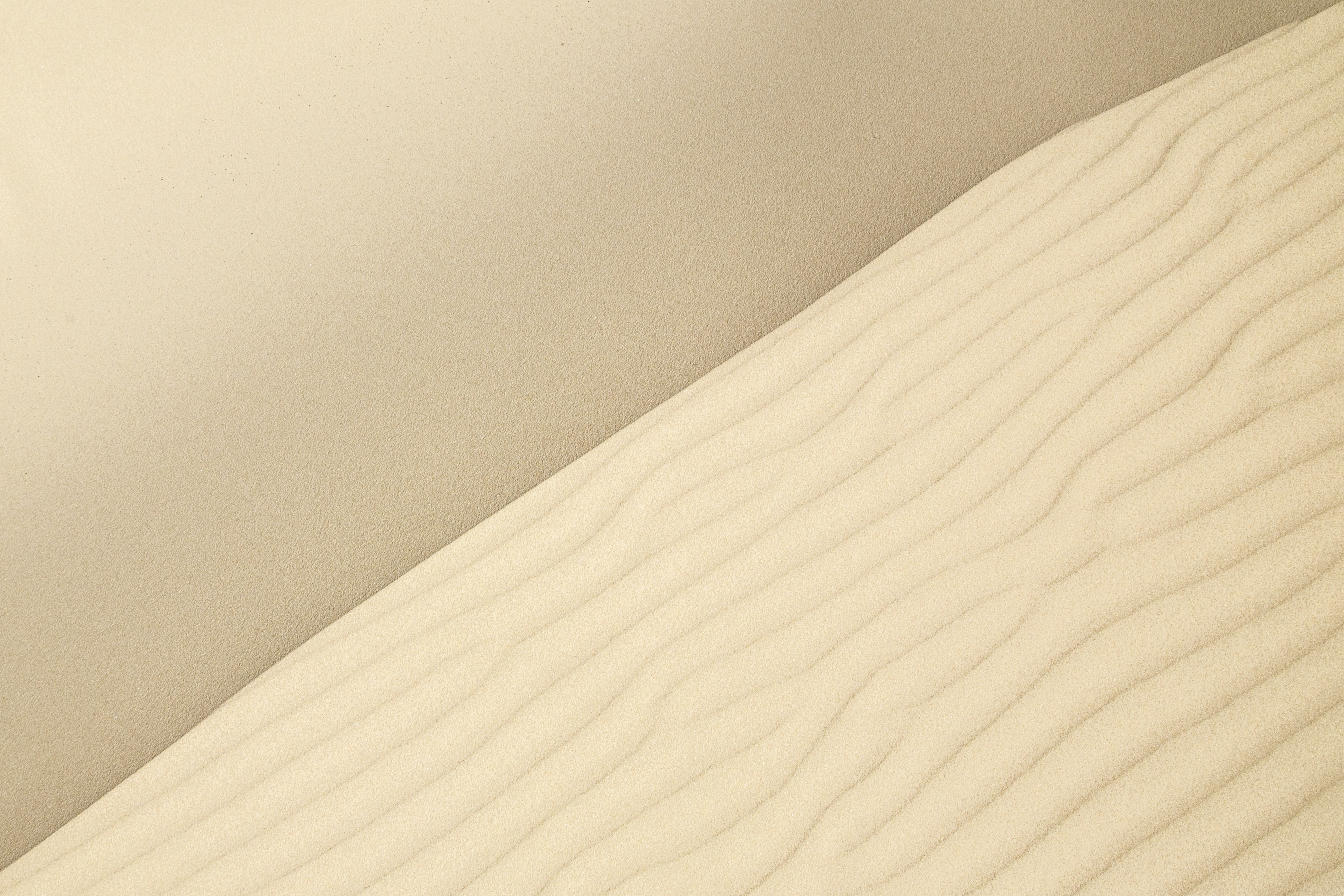 Ripples in the dry sands of a white air desert