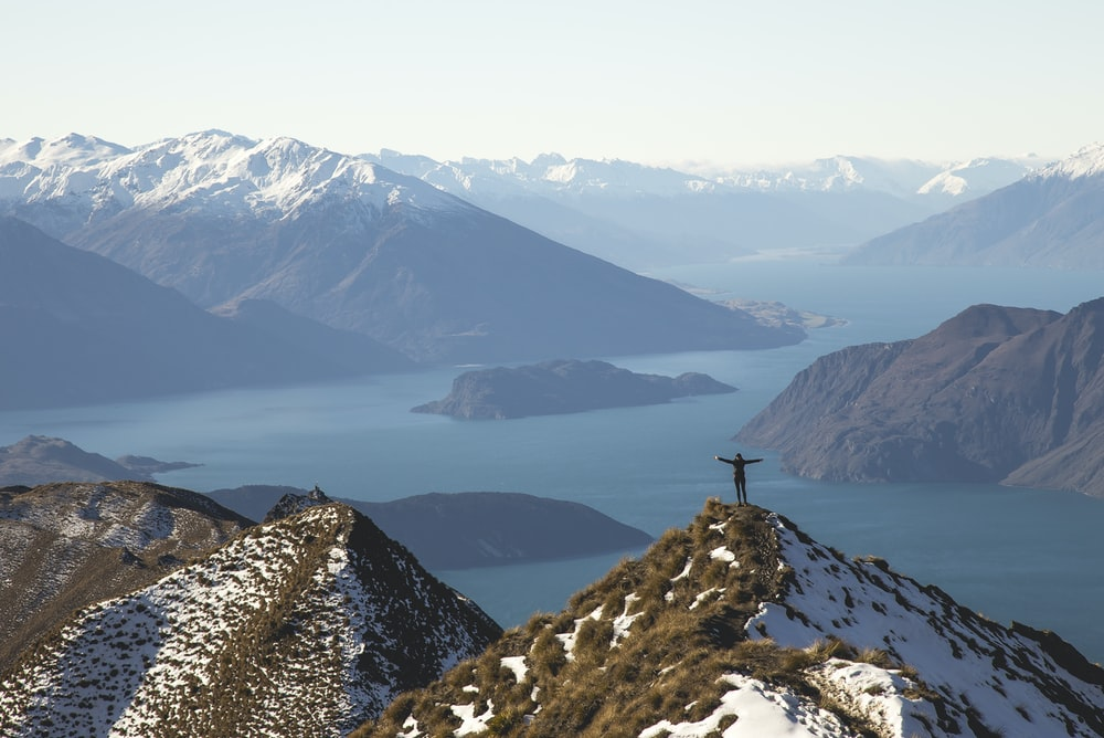 person standing on a mountain
