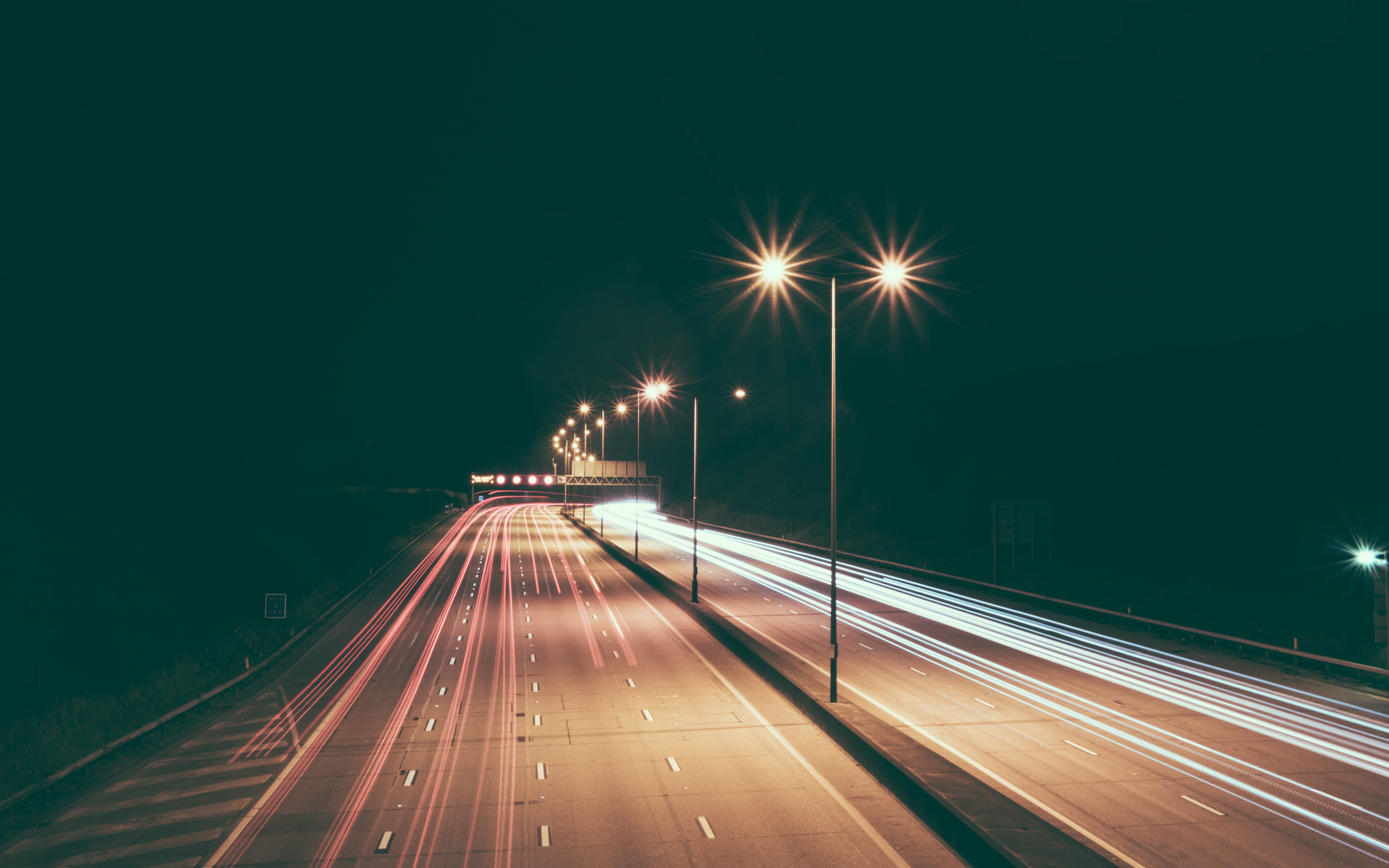 timelapse photography of road lights