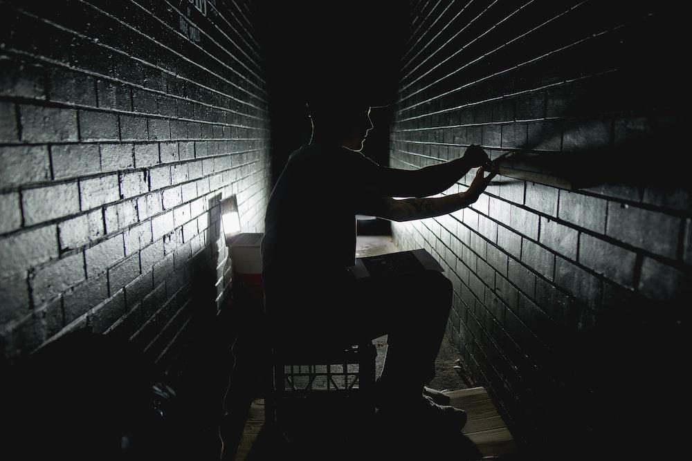 person sitting on dark room