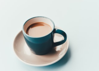 cup of coffee with saucer