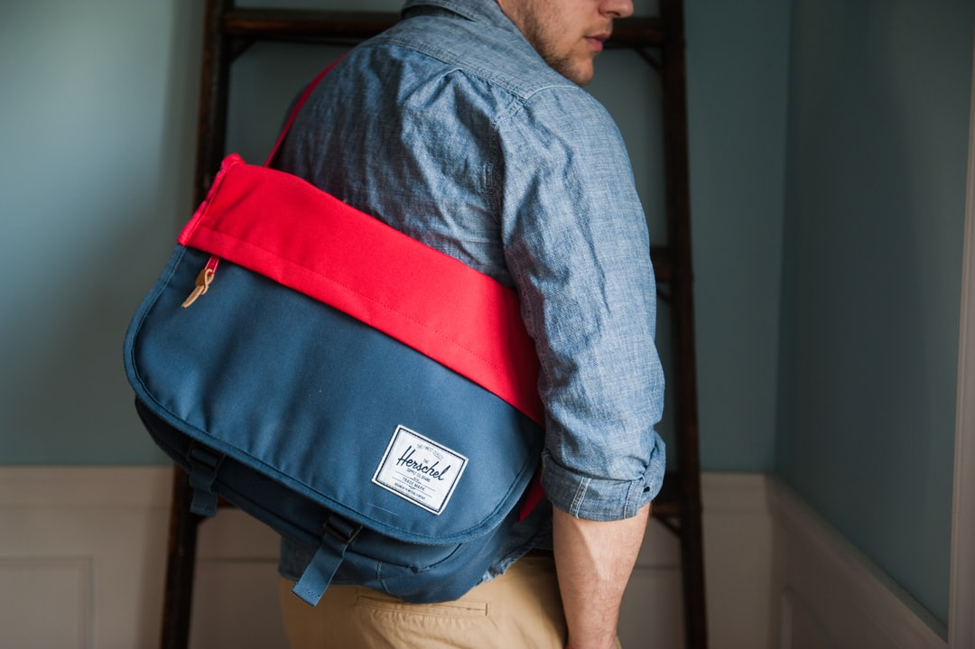 Man with a red and blue bag