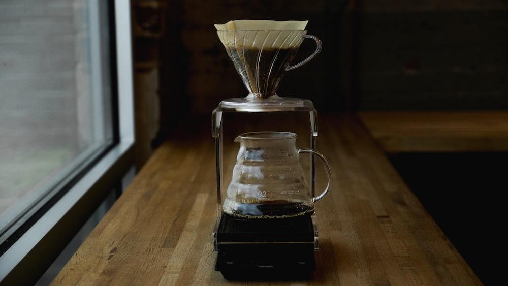 coffee pitcher on table near window