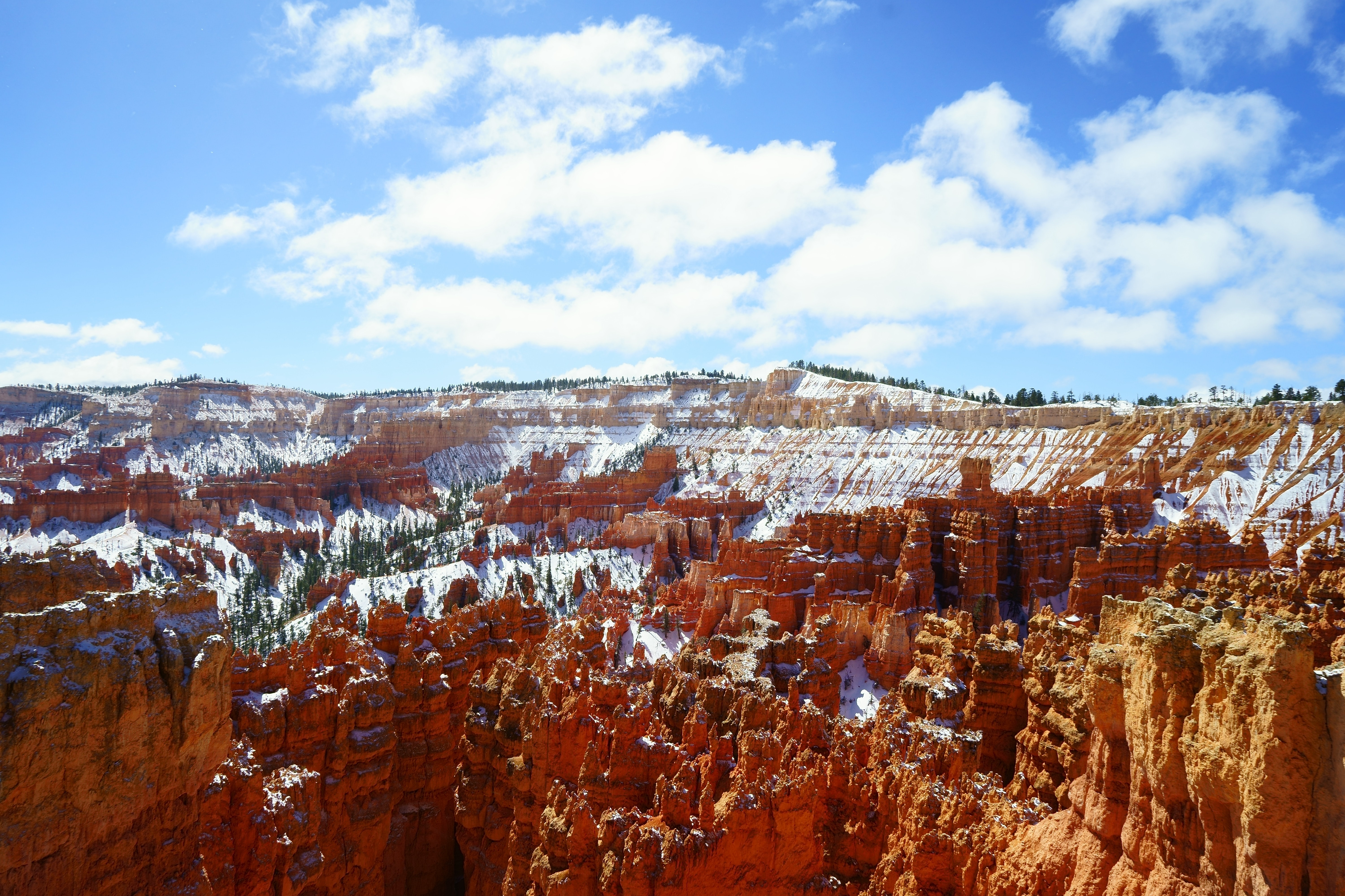 Red rock formations covered in snow at Bryce Canyon National Park