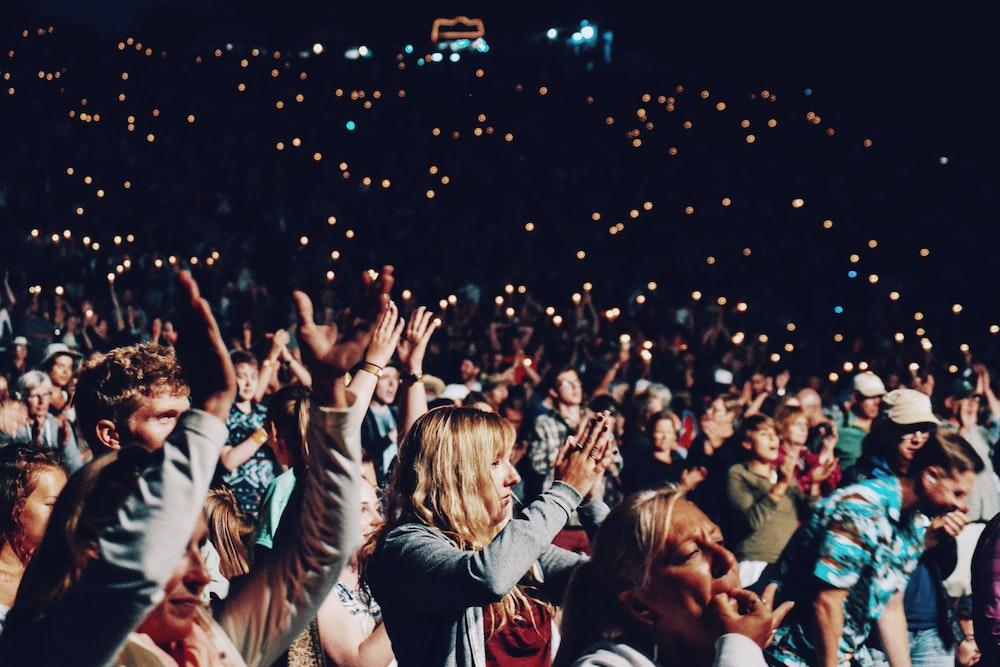 people racing smartphones on concert