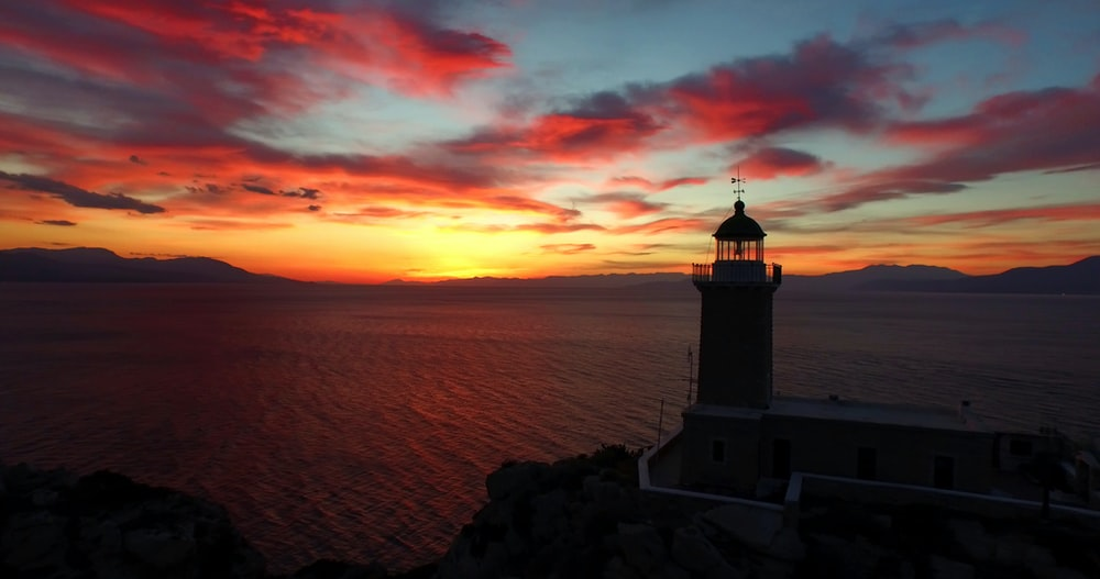 photo of lighthouse and a sunset