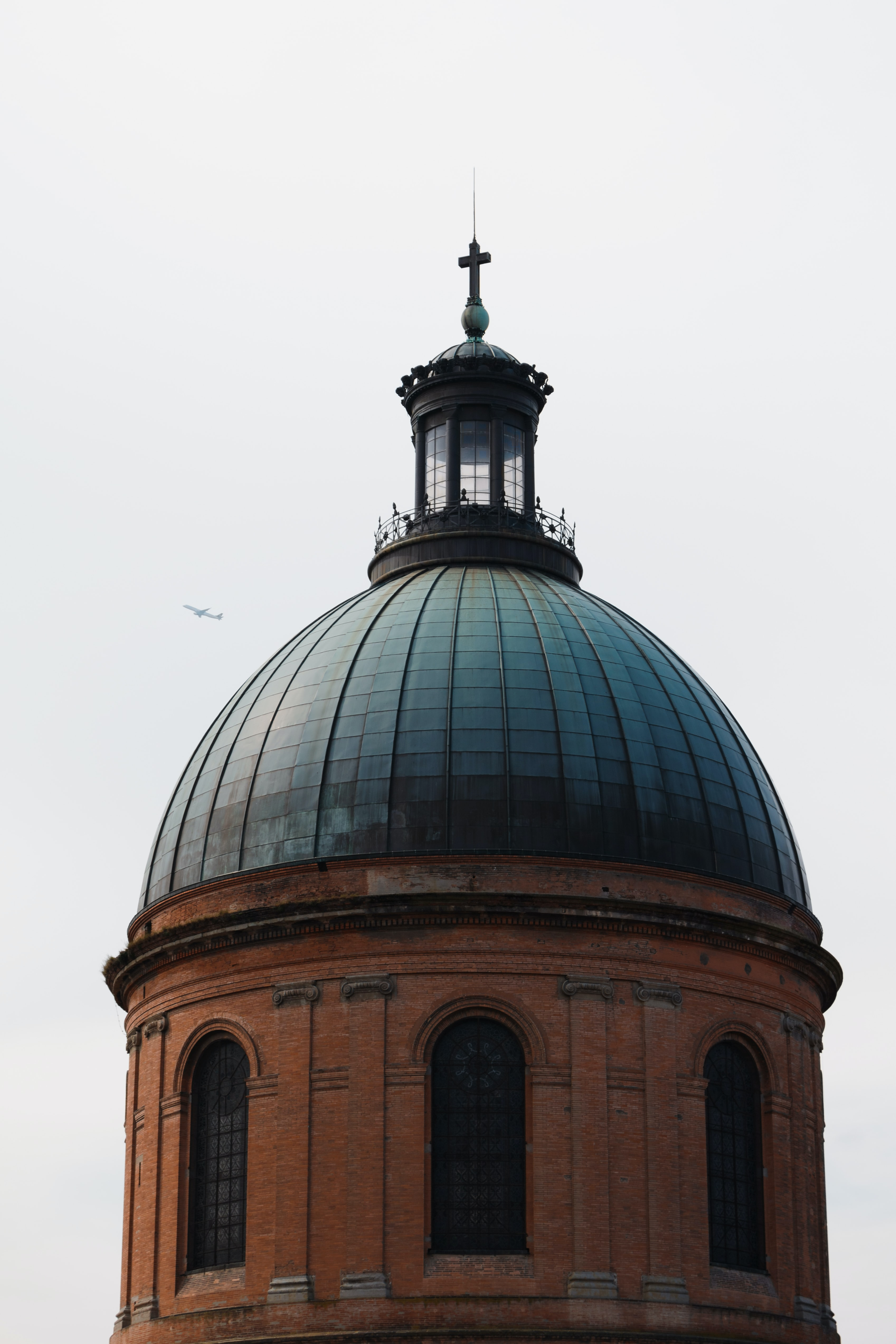 Dome of Hôpital de La Grave with cross at the top and dark windows