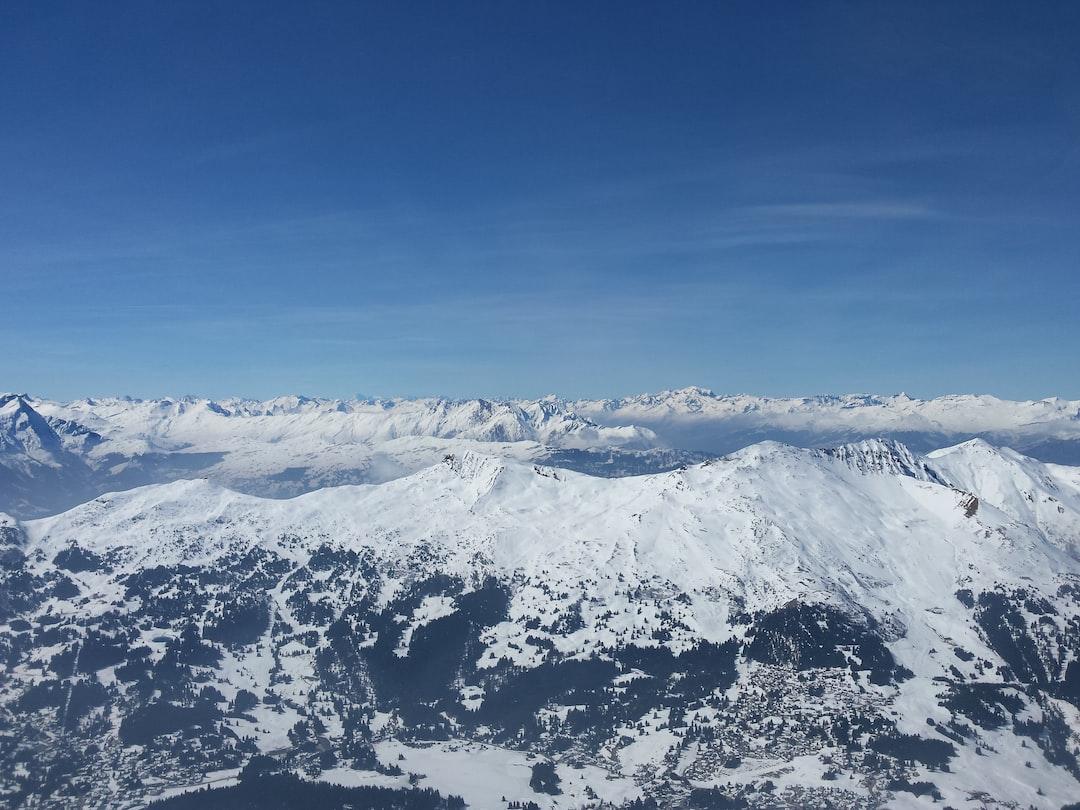 Snowy Mountains Under Blue Sky