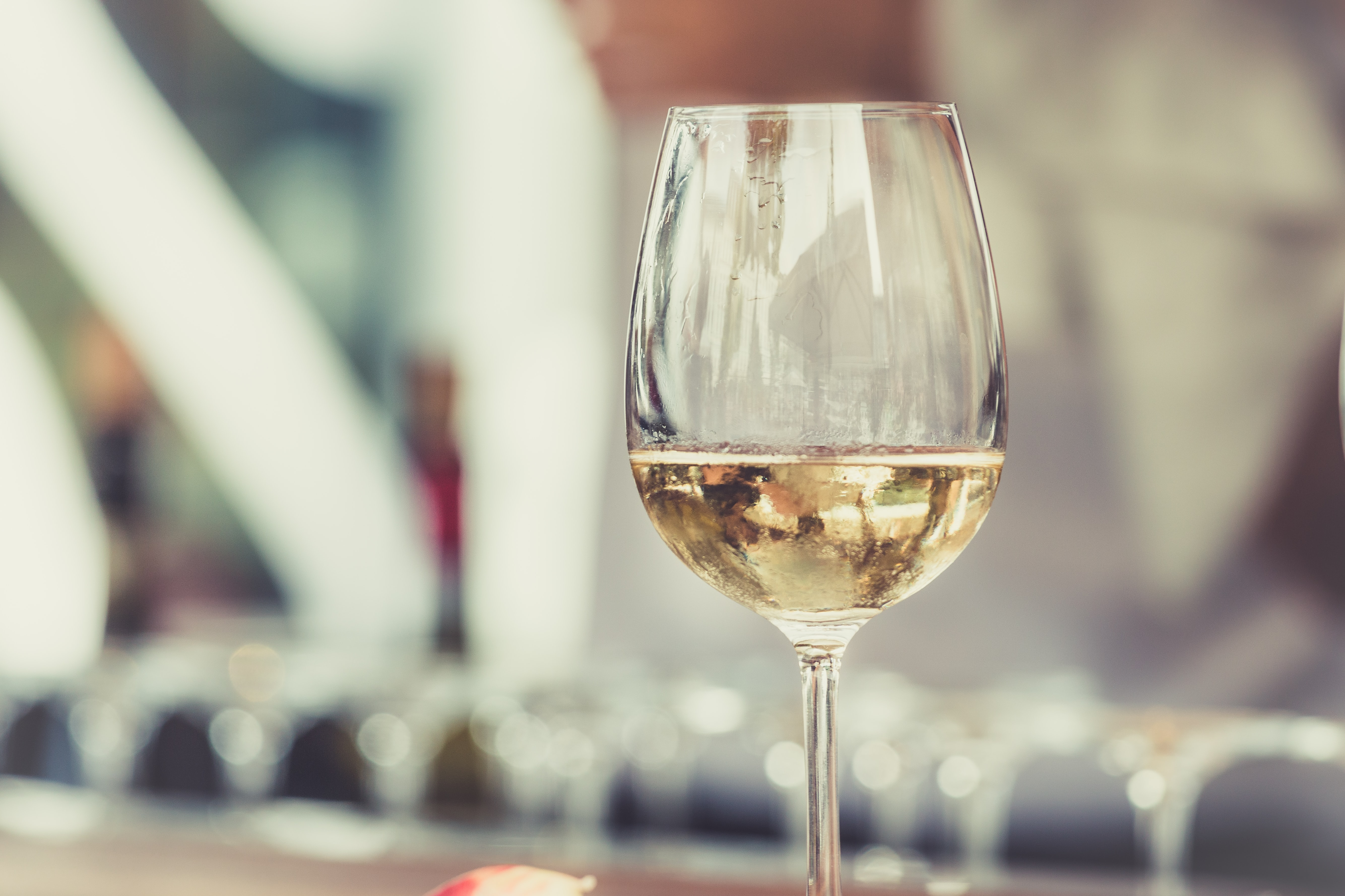 Macro view of a wine glass with wine in it in Torvehallerne