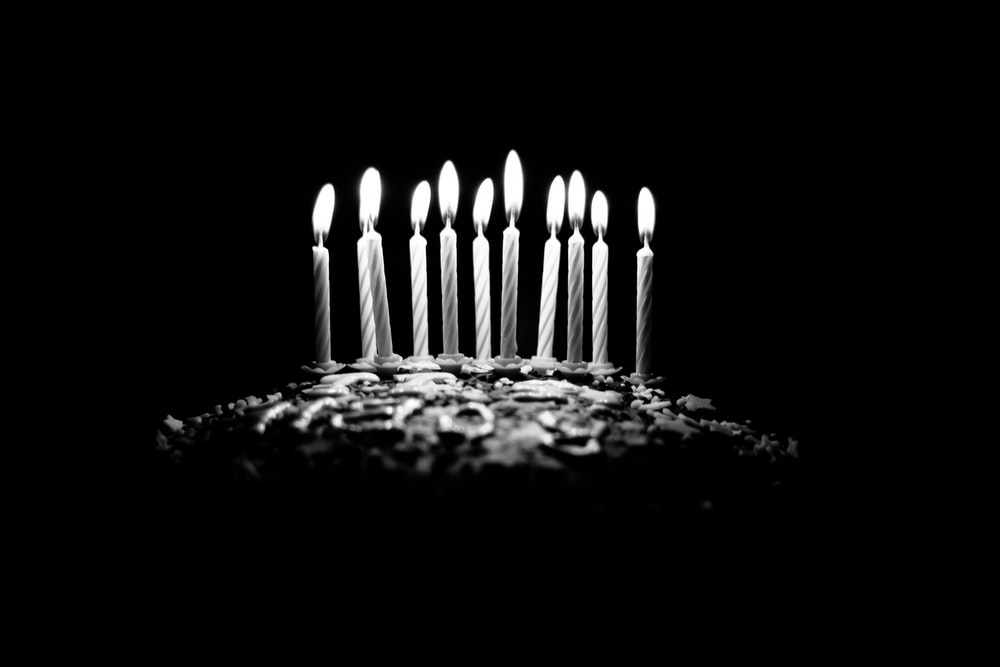 grayscale photography of lighted birthday candles
