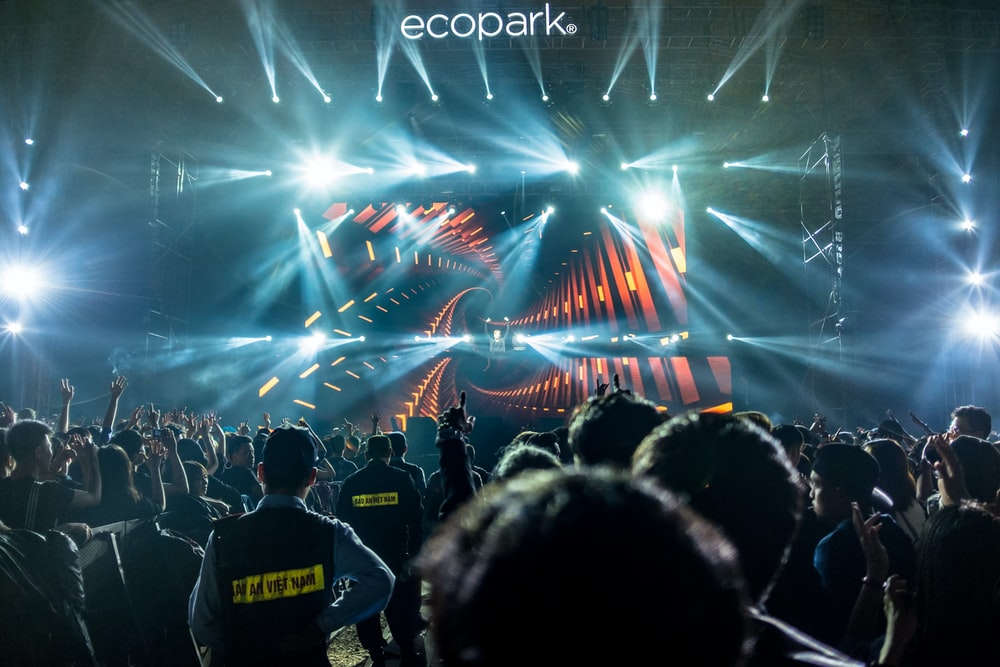 people standing in front of Eco Park stage