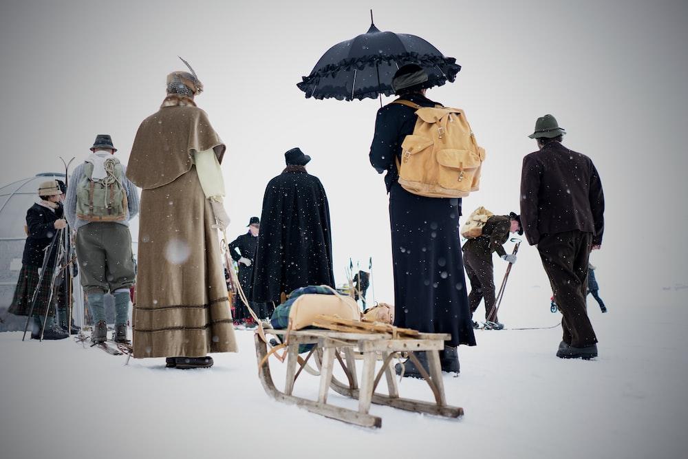 people walking in snowy day
