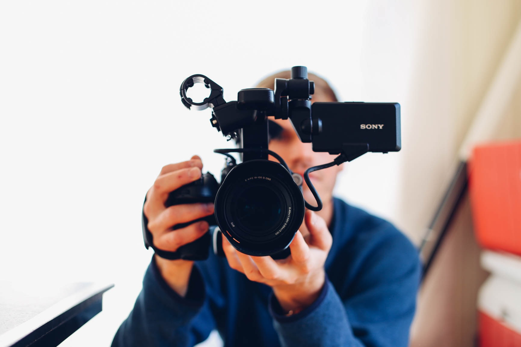 A man holding a Sony video camera