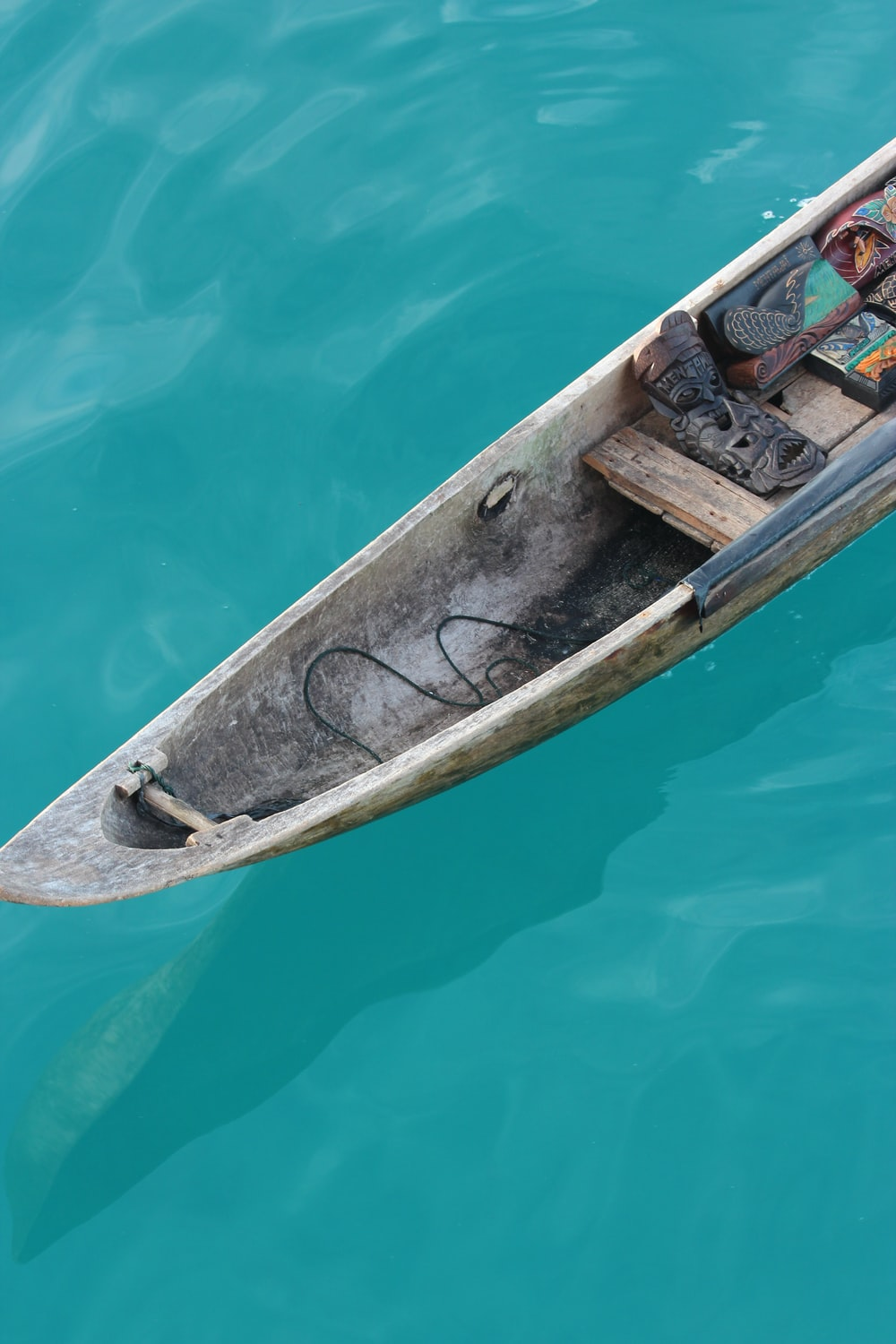 tribal mask on brown boat