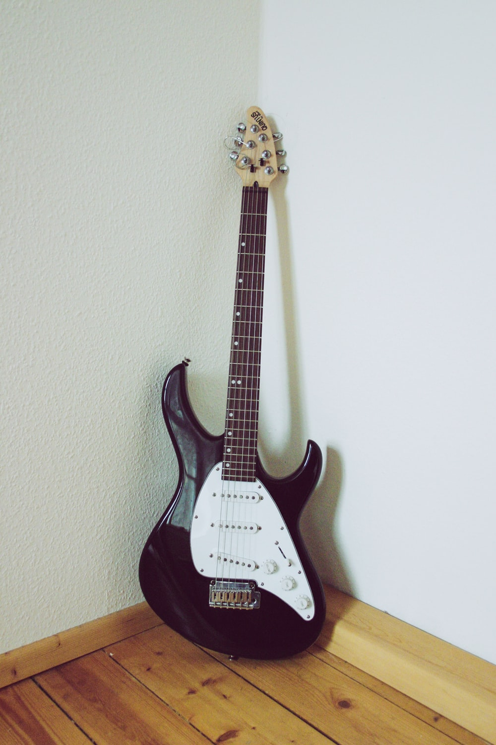 black and white stratocaster electric guitar