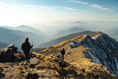 person on top of mountain during daytime hiking teams background