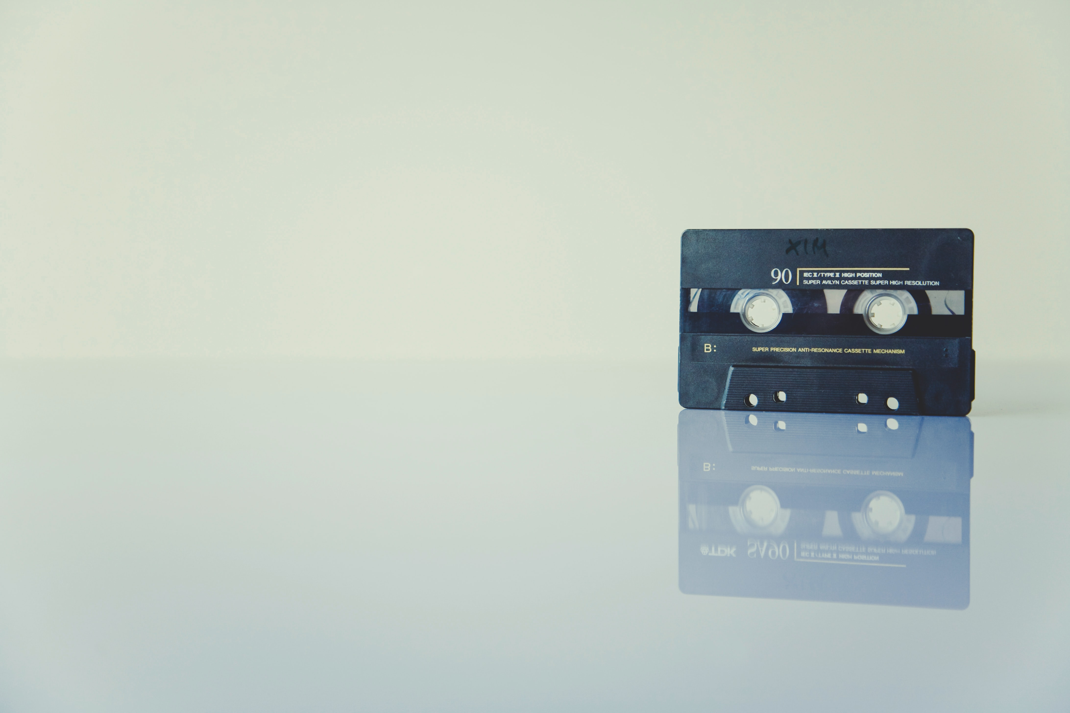 A cassette tape on a flat reflective surface
