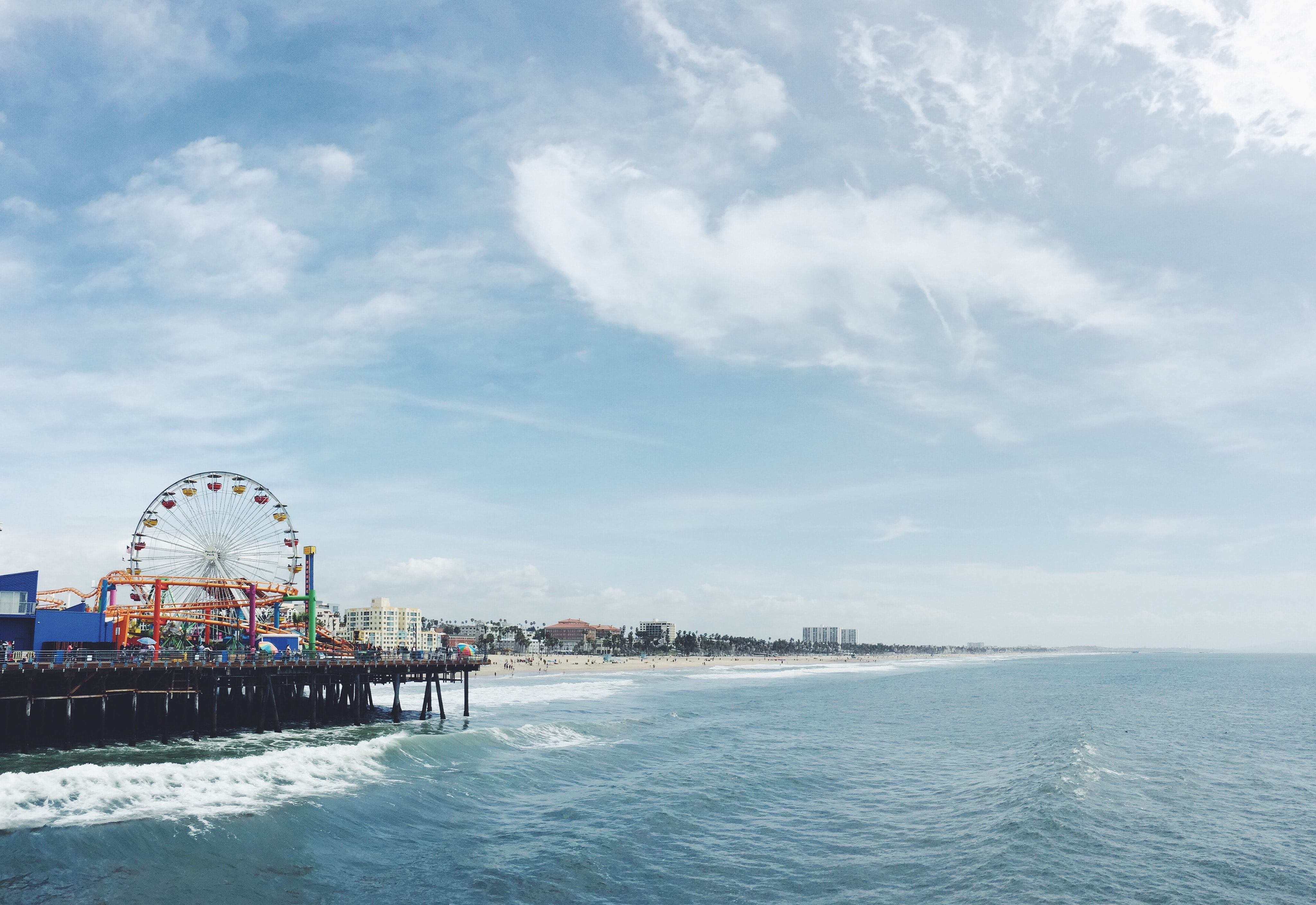A Ferris wheel and other rides on the Santa Monica pier in California