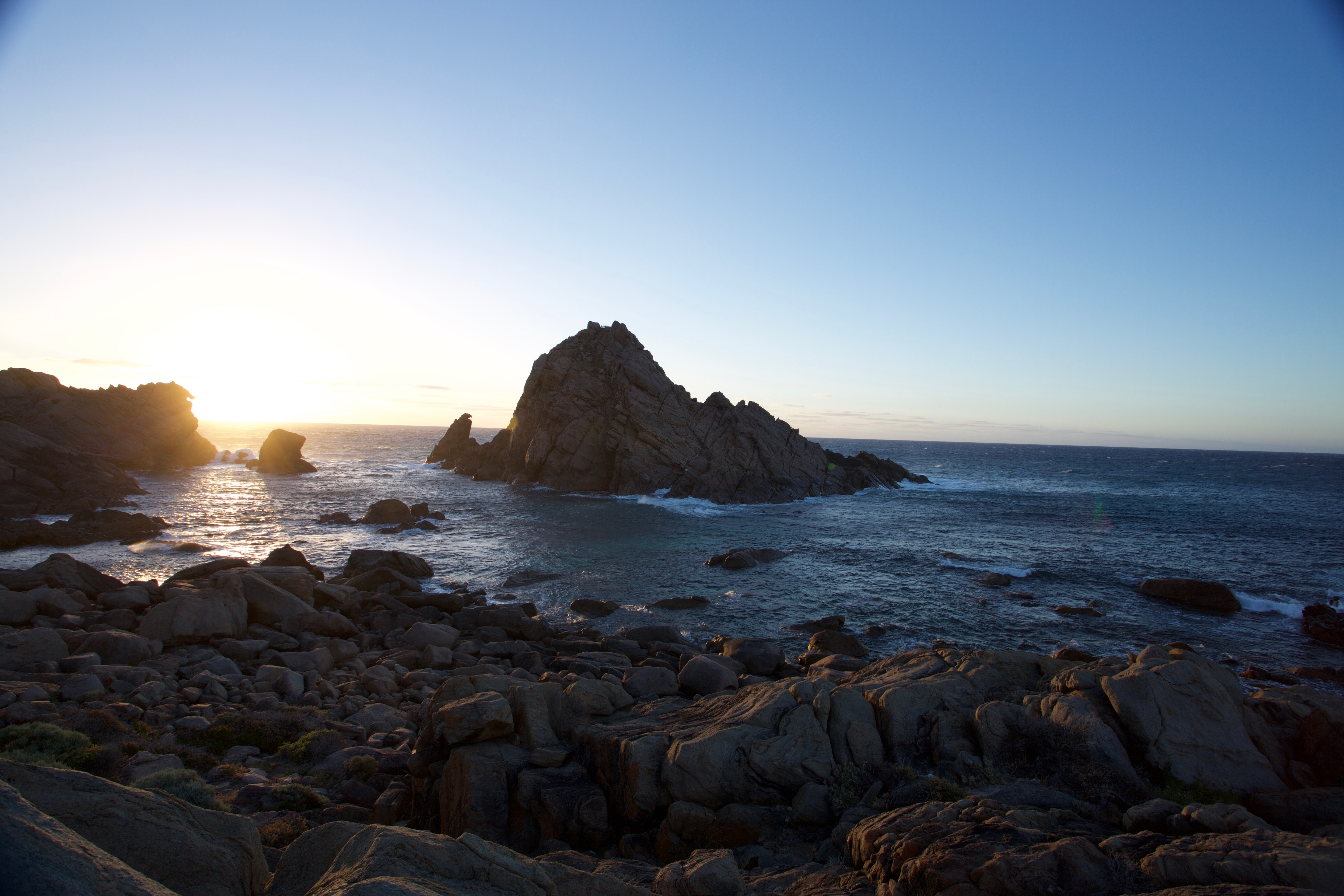 Ocean rock formations by the rocky coast in Dunsborough at sunset