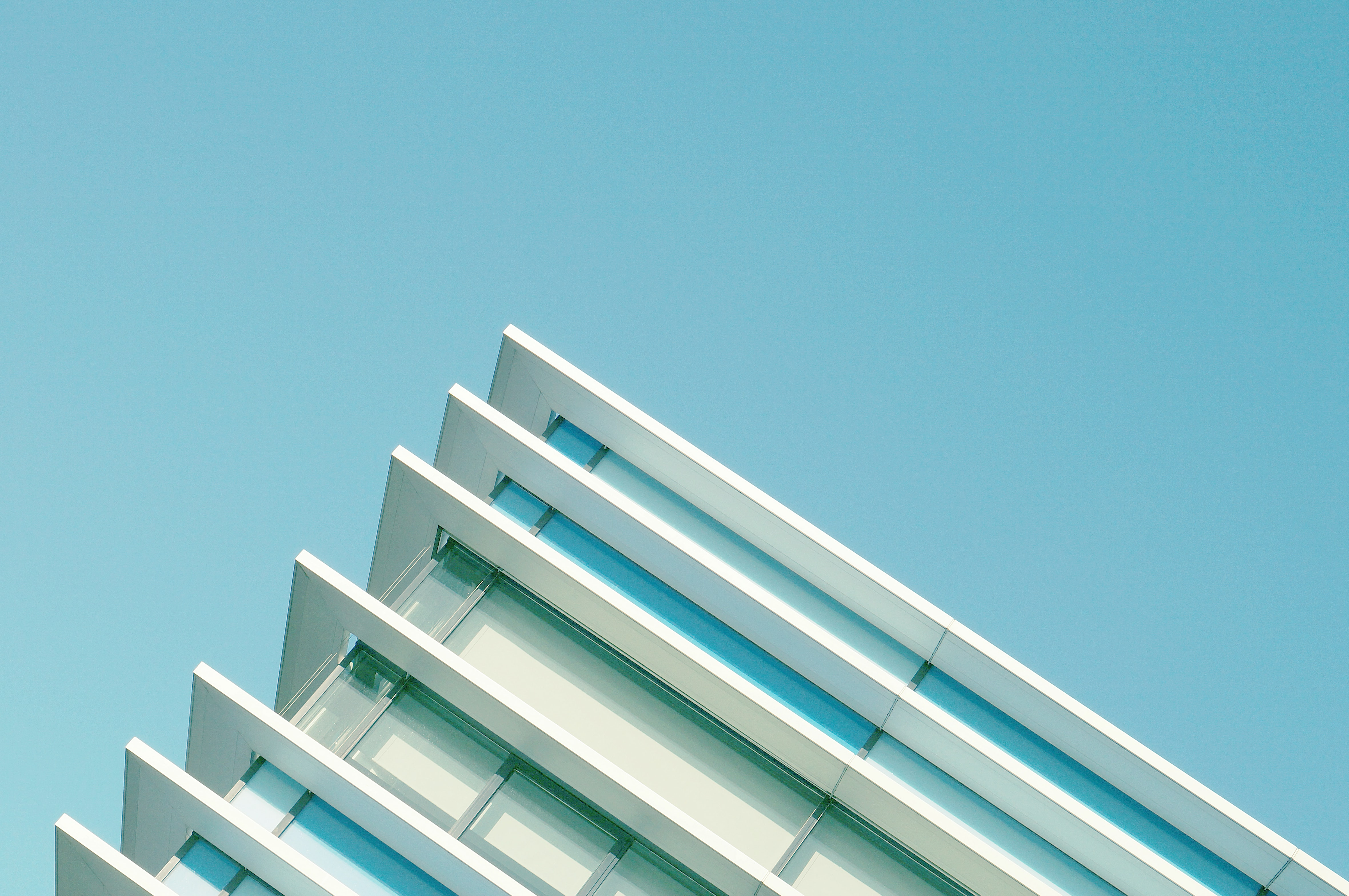 The top edge of a modern building in Aarhus, Denmark against a blue sky