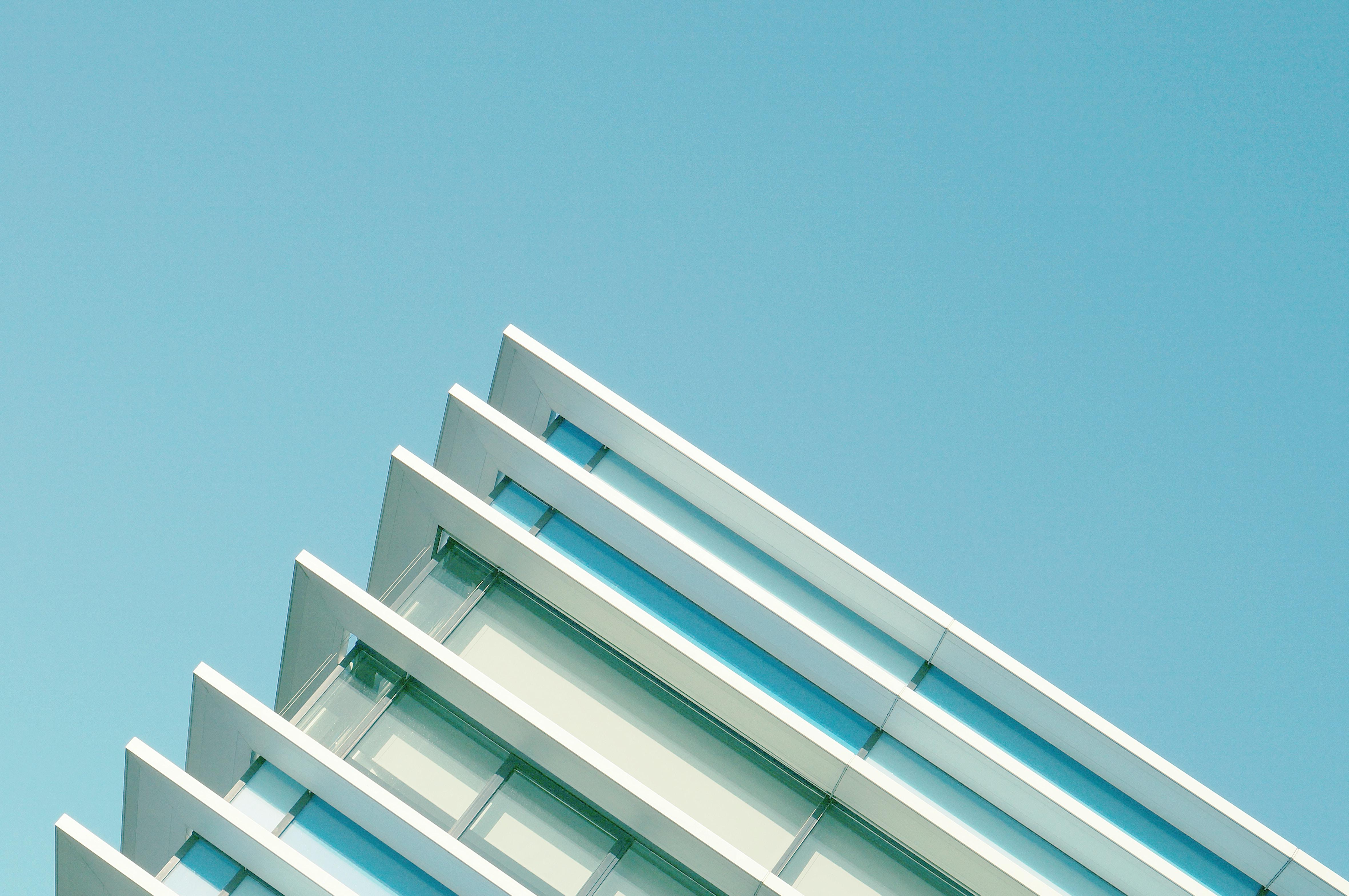 The top edge of a modern building in Aarhus, Denmark against a blue sky